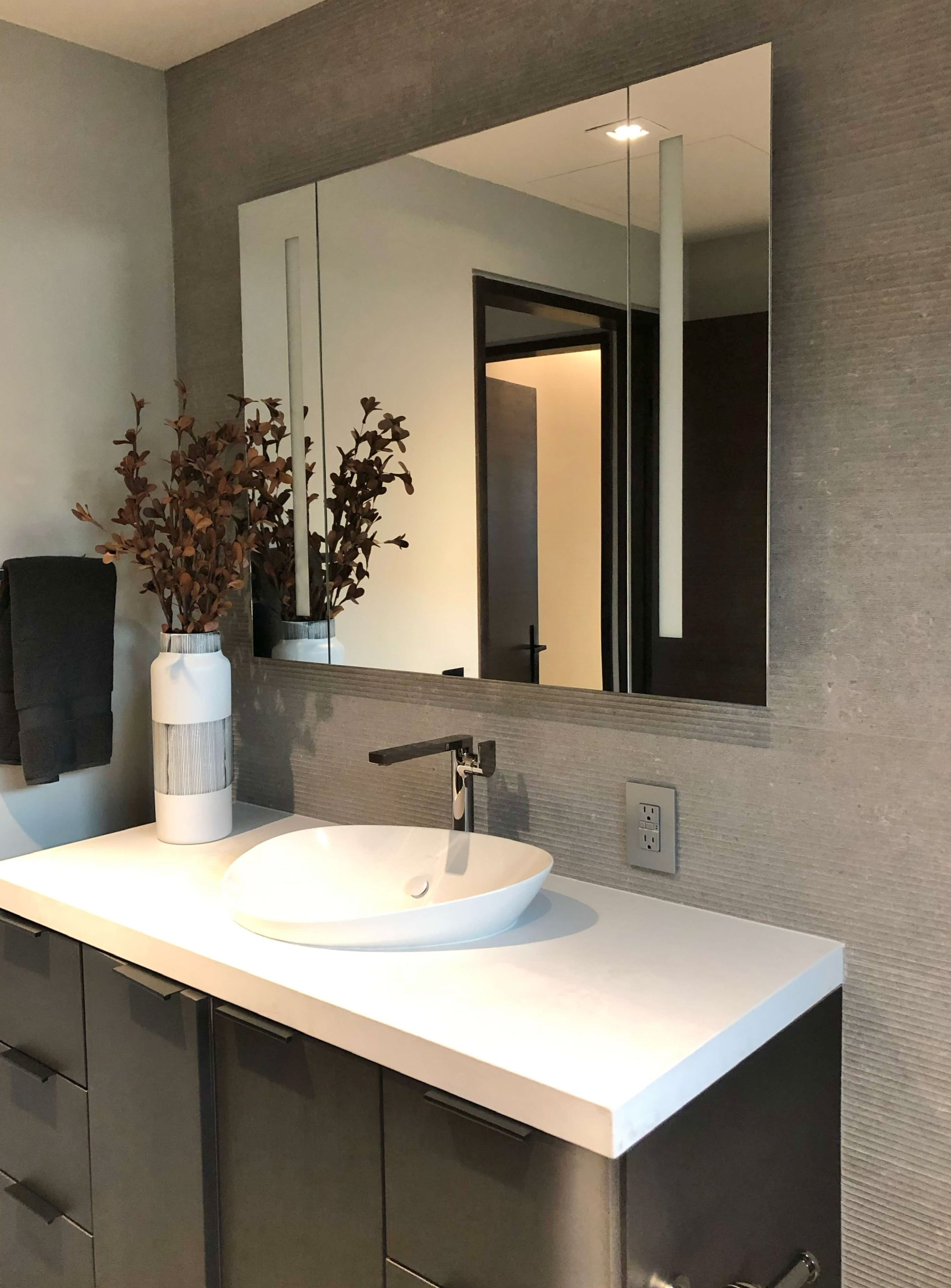 Guest bath vanity with contemporary medicine cabinet on tiny mosaic tiled wall in The New American Remodel 2019. #hometour #vesselsink #bathroom #contemporaryhome #medicinecabinet