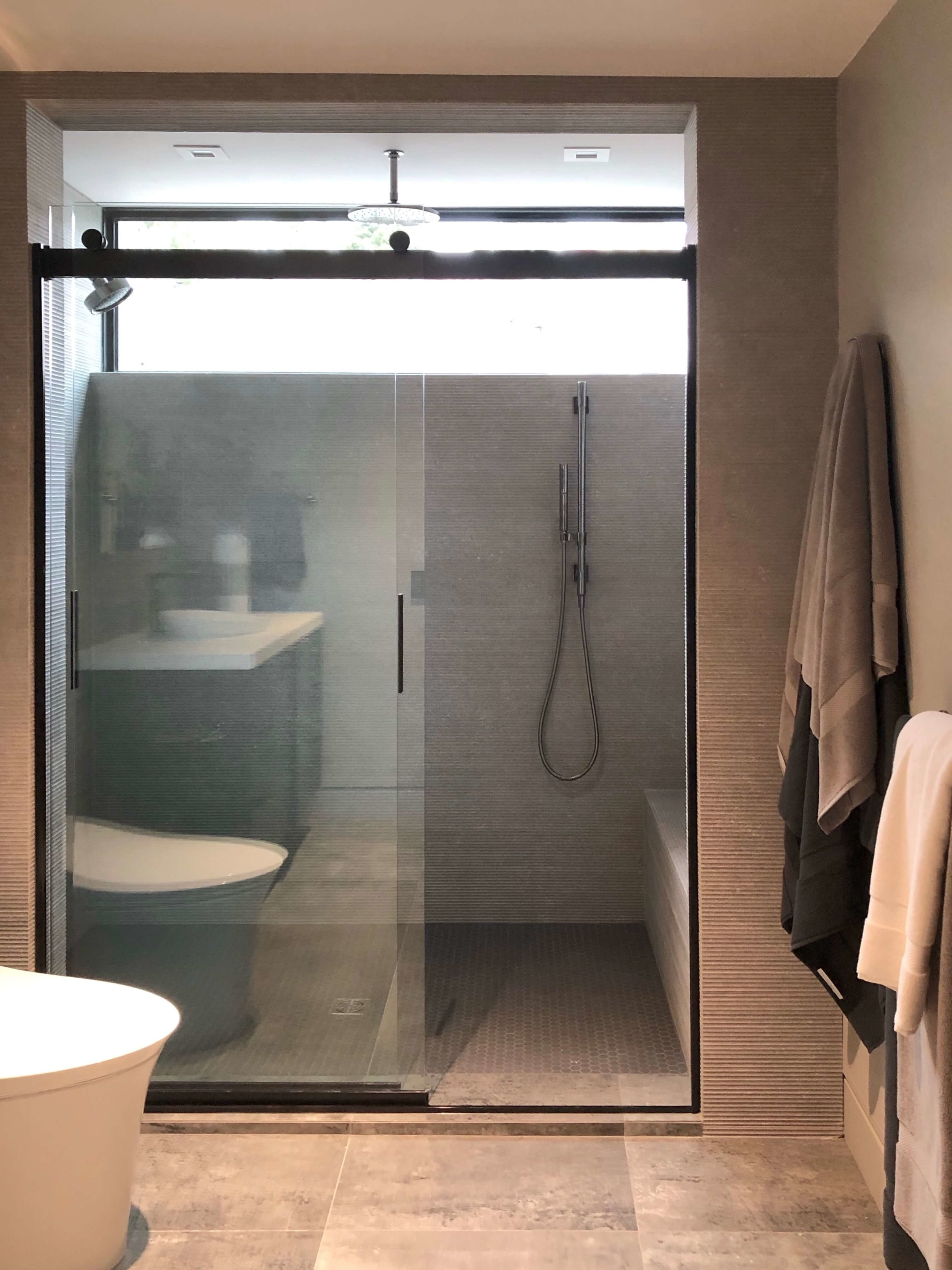Guest bathroom shower in The New American Remodel 2019. #hometour #shower #contemporaryhome