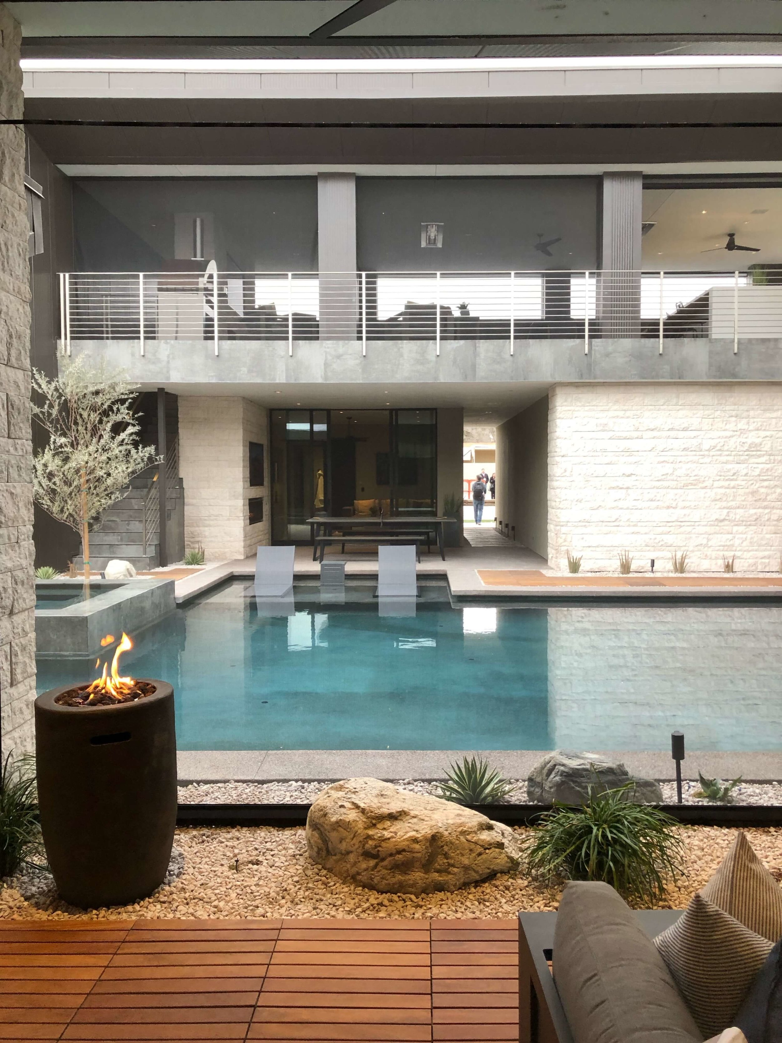 View from the patio off the living room to the pool in The New American Remodel 2019. #hometour #patio #contemporaryhome #pool