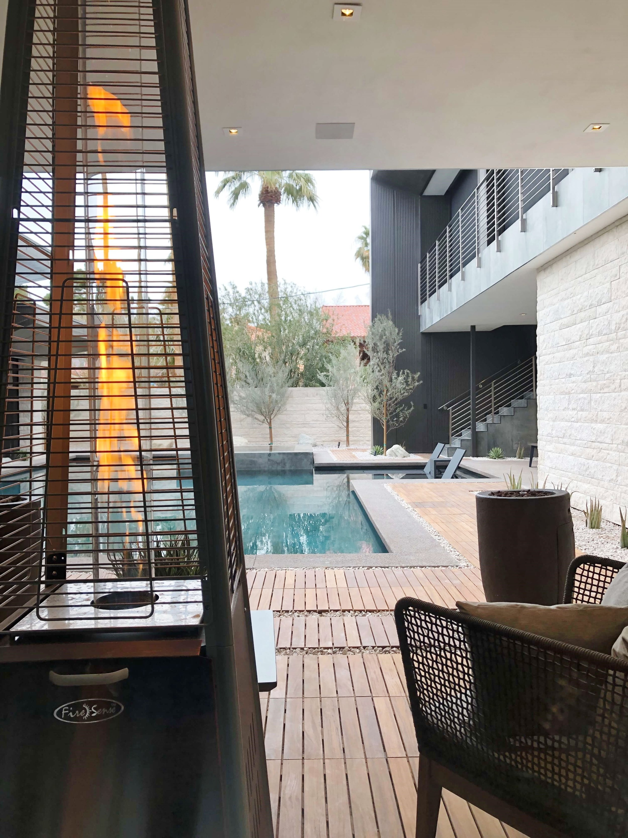 View from the mudroom/laundry area behind the kitchen to the pool courtyard in The New American Remodel 2019. #hometour #patio #contemporaryhome #pool