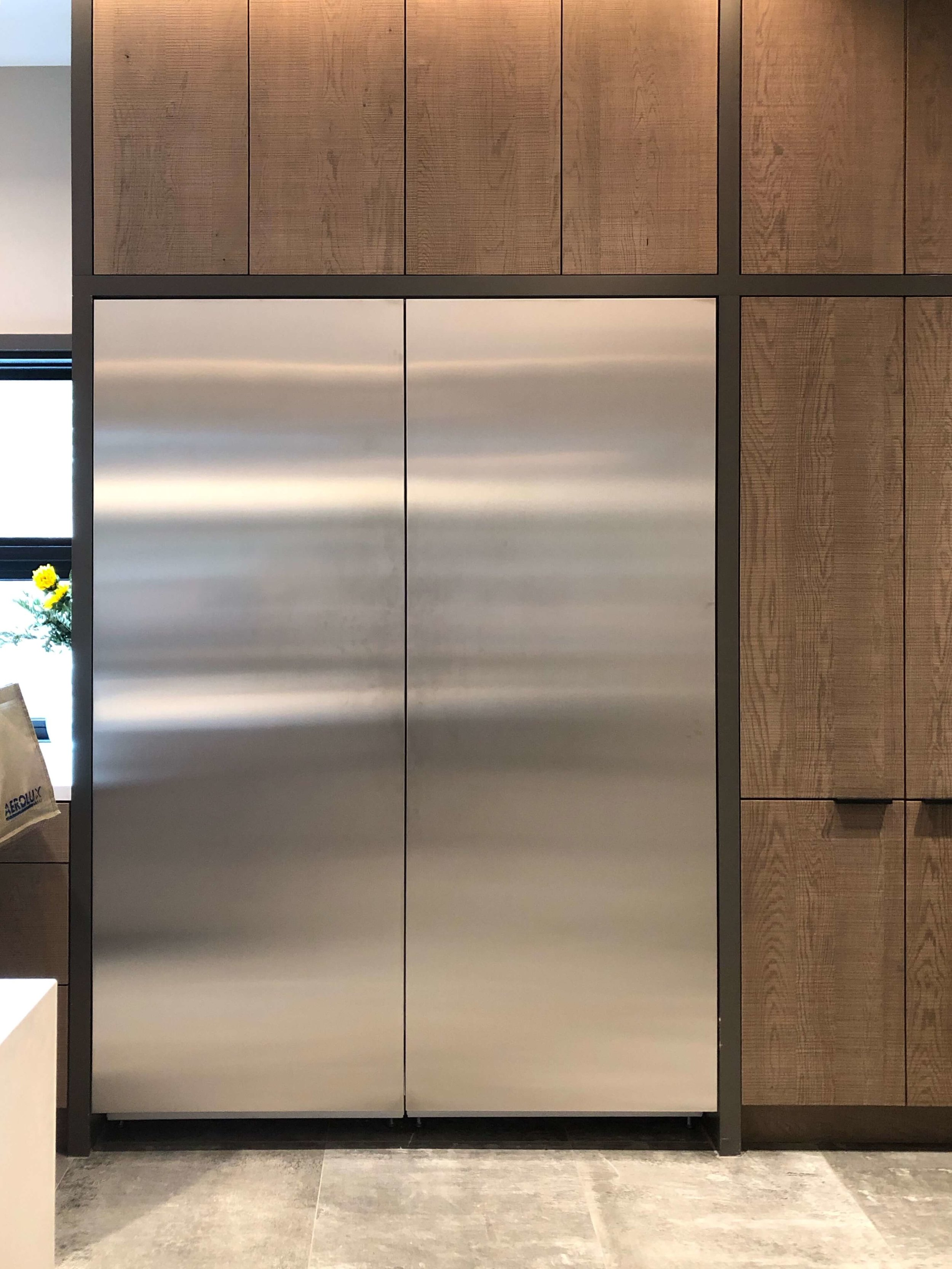 Touchlatch refrigeration with no handles on the stainless panels in the kitchen of The New American Remodel 2019. #hometour #refrigerator #kitchen #contemporaryhome
