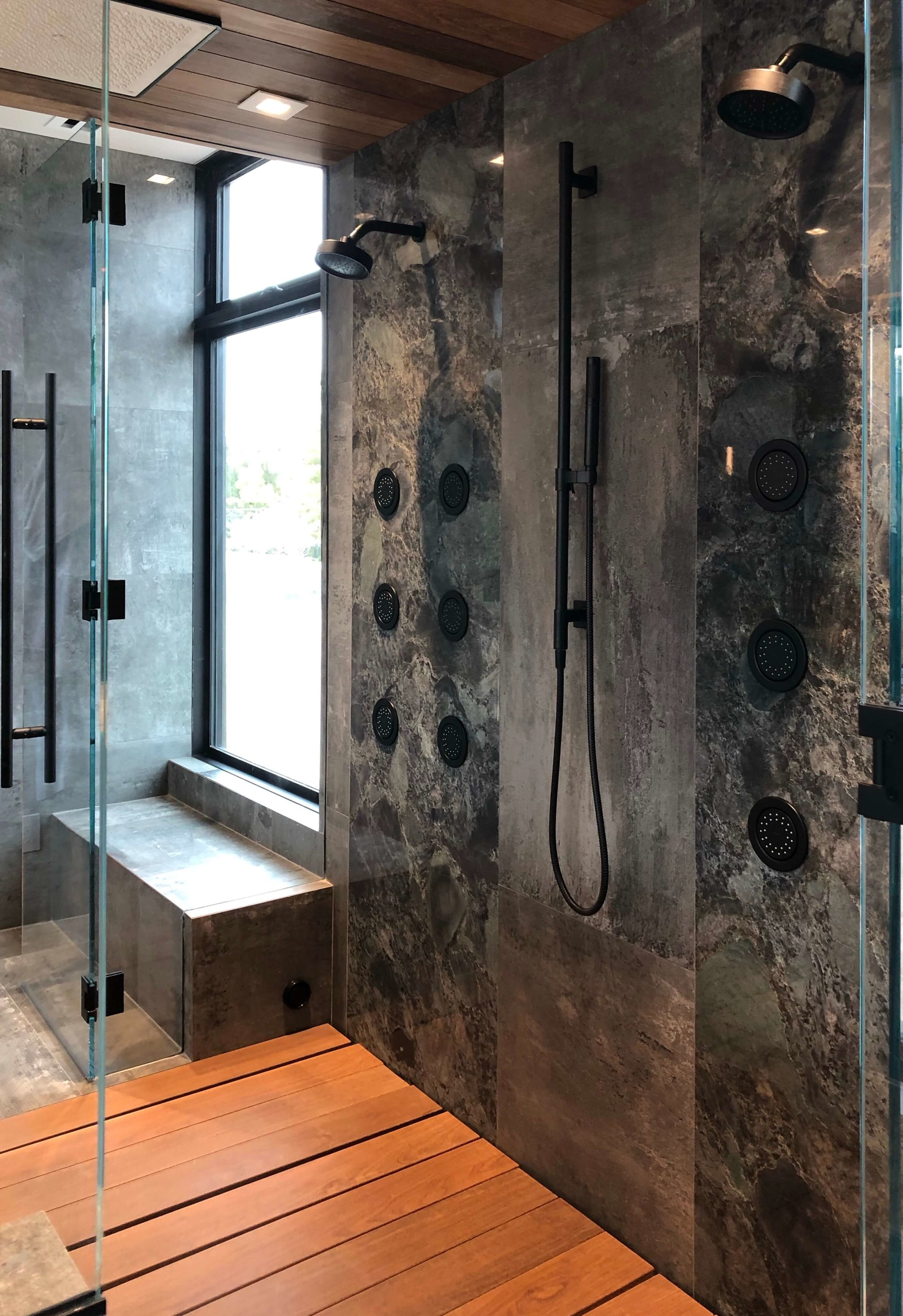 Master bath double shower with body sprays in The New American Remodel 2019. #masterbathroom #hometour #contemporaryhome