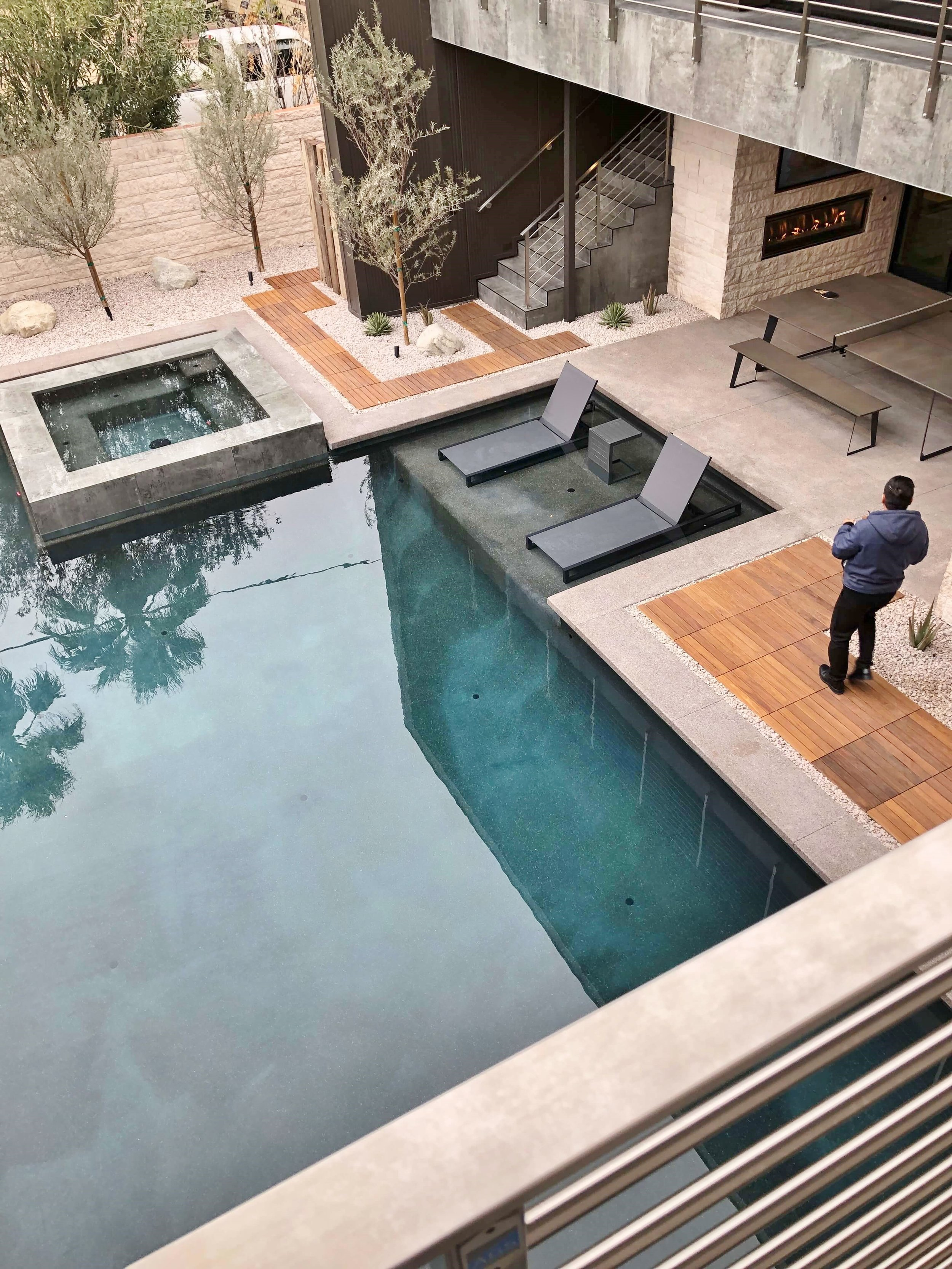 This luxury pool oasis sits in a courtyard of The New American Remodel 2019. #masterbathroom #hometour #contemporaryhome