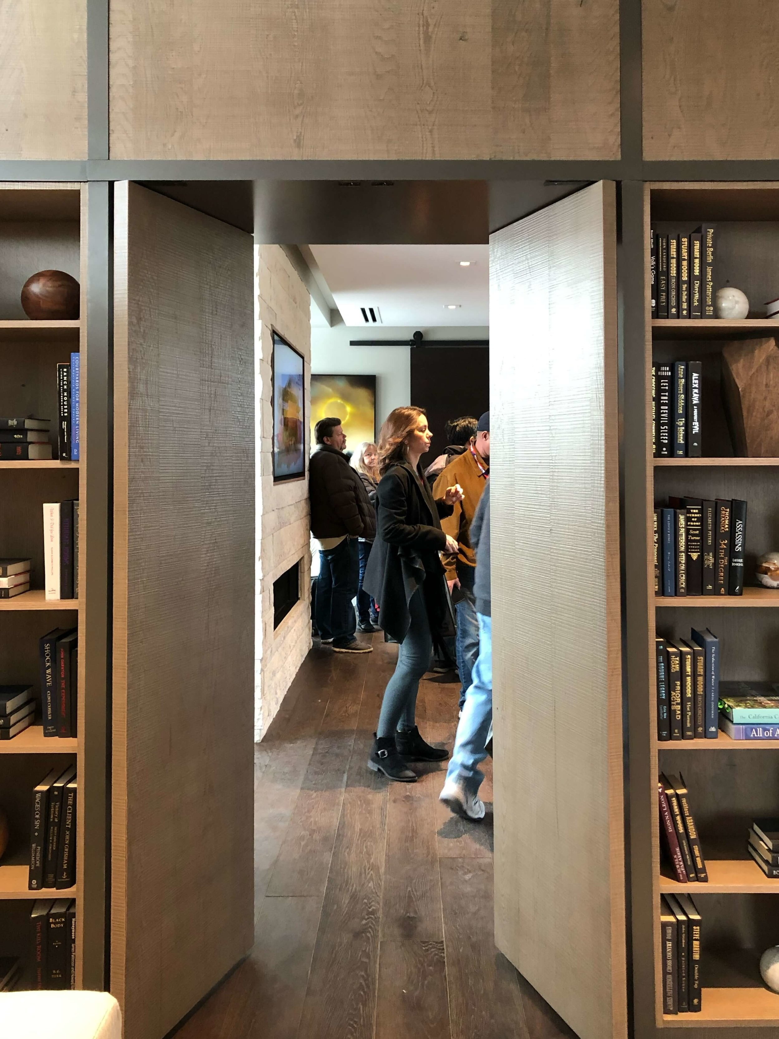 Wood pivot doors make a sleek entrance for the master suite in The New American Remodel 2019. #masterbedroom #hometour #contemporaryhome #pivotdoor