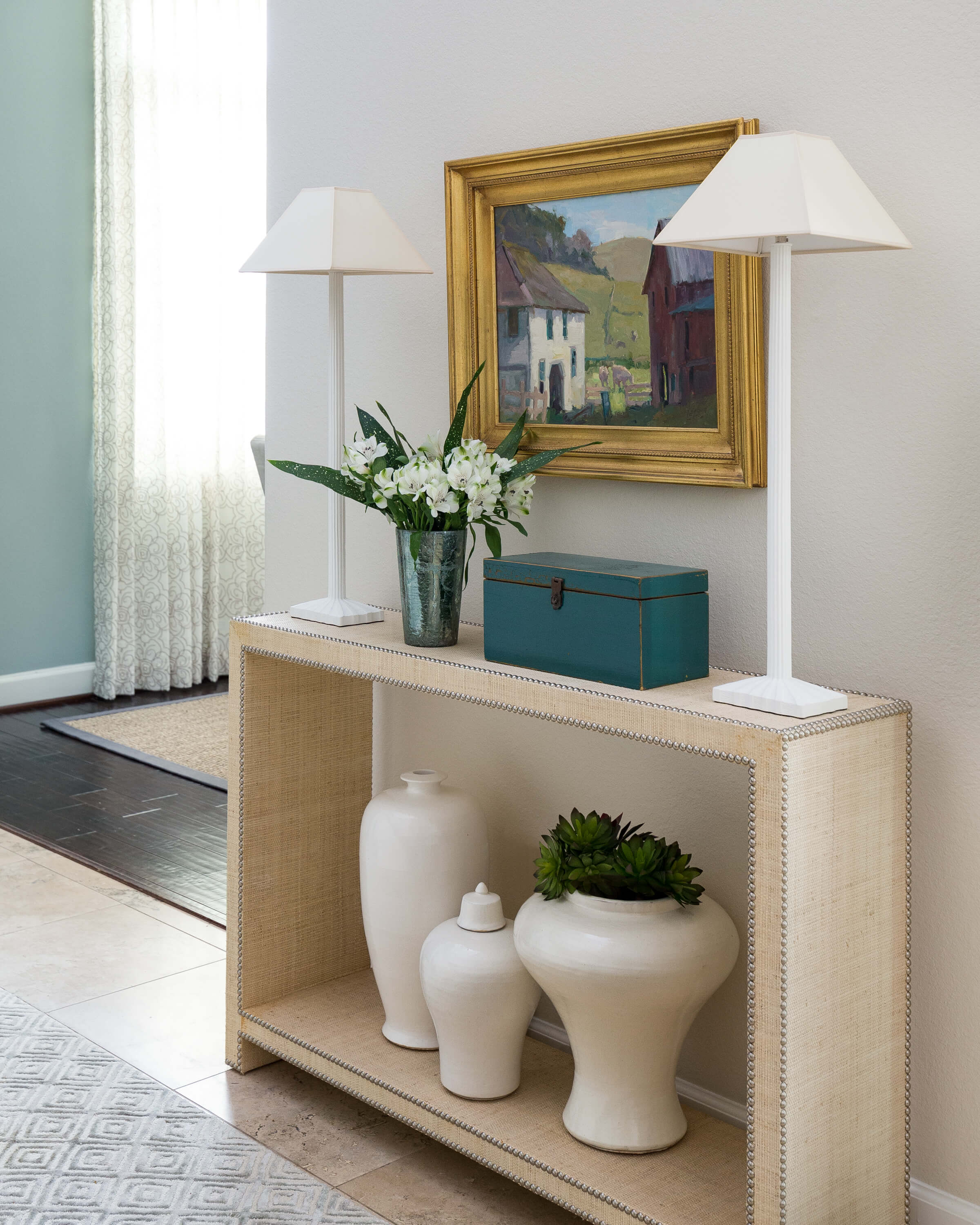 White plaster buffet lamps go with the coastal vibe in this entry hall on one of my projects. Carla Aston, Designer | Colleen Scott, Photographer