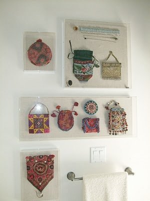 Beaded purses in plexi boxes as wall decor | Boho style