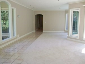 BEFORE remodel - tile path with carpet needed an update in the living and dining room.