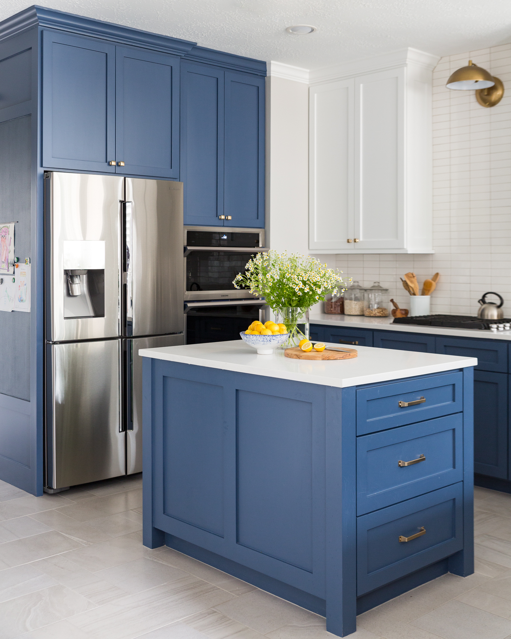 Kitchen remodel - new island with navy cabinets and white quartz countertop in rectangular shape   Carla Aston, Designer #kitchenisland #navycabinets #kitchenremodelingideas