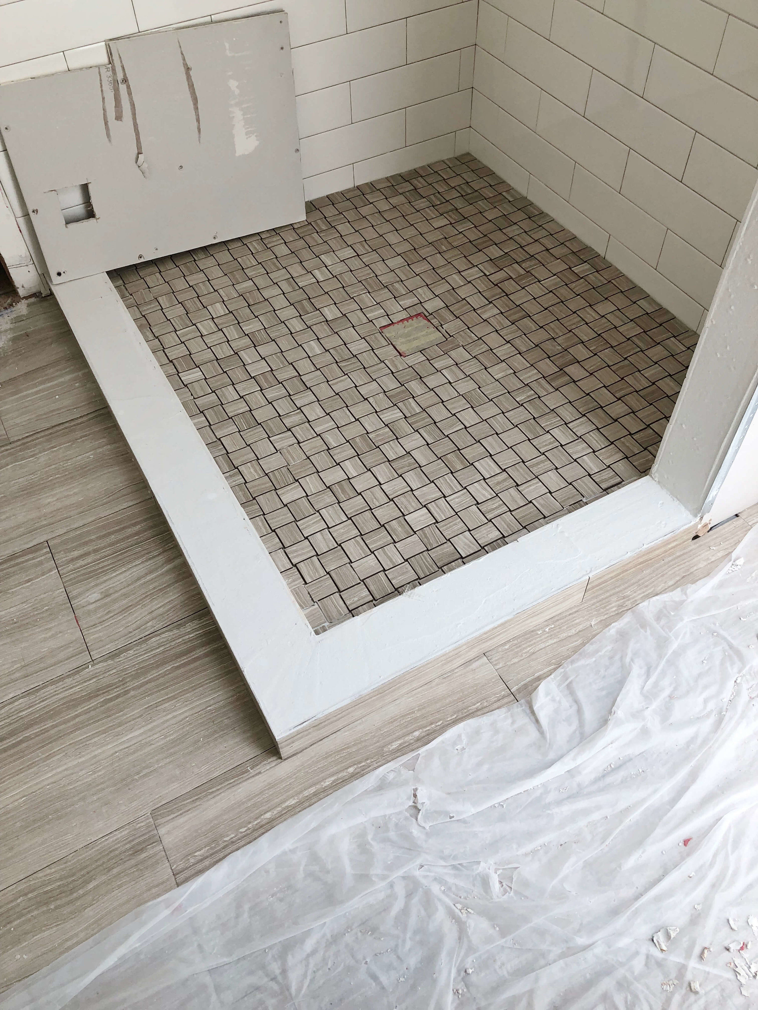 Here's one of my current projects under construction. We were going to do a slab curb with the white quartz material we had for the countertop, but when I saw this, I knew the tile would be a better option. #showerstall #bathroomdesign