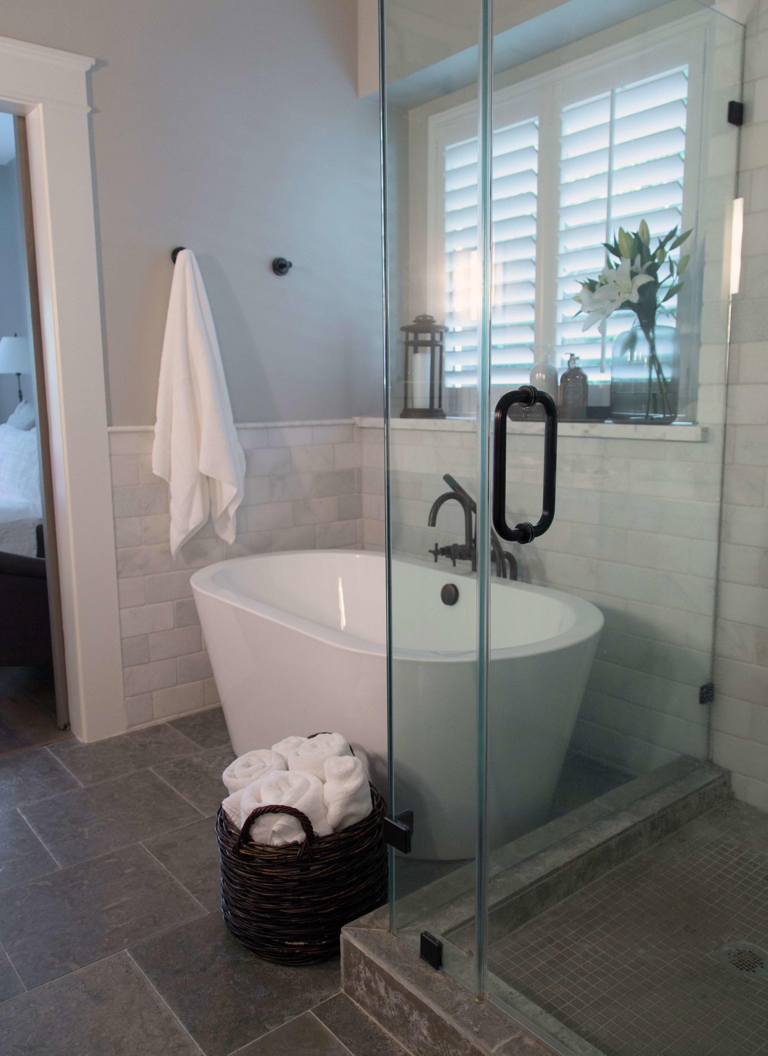 Bathroom shower curb in tile material that matches bathroom floor with frameless glass shower. Carla Aston, Designer | Tori Aston, Photographer #shower #showertile #bathroomdesign