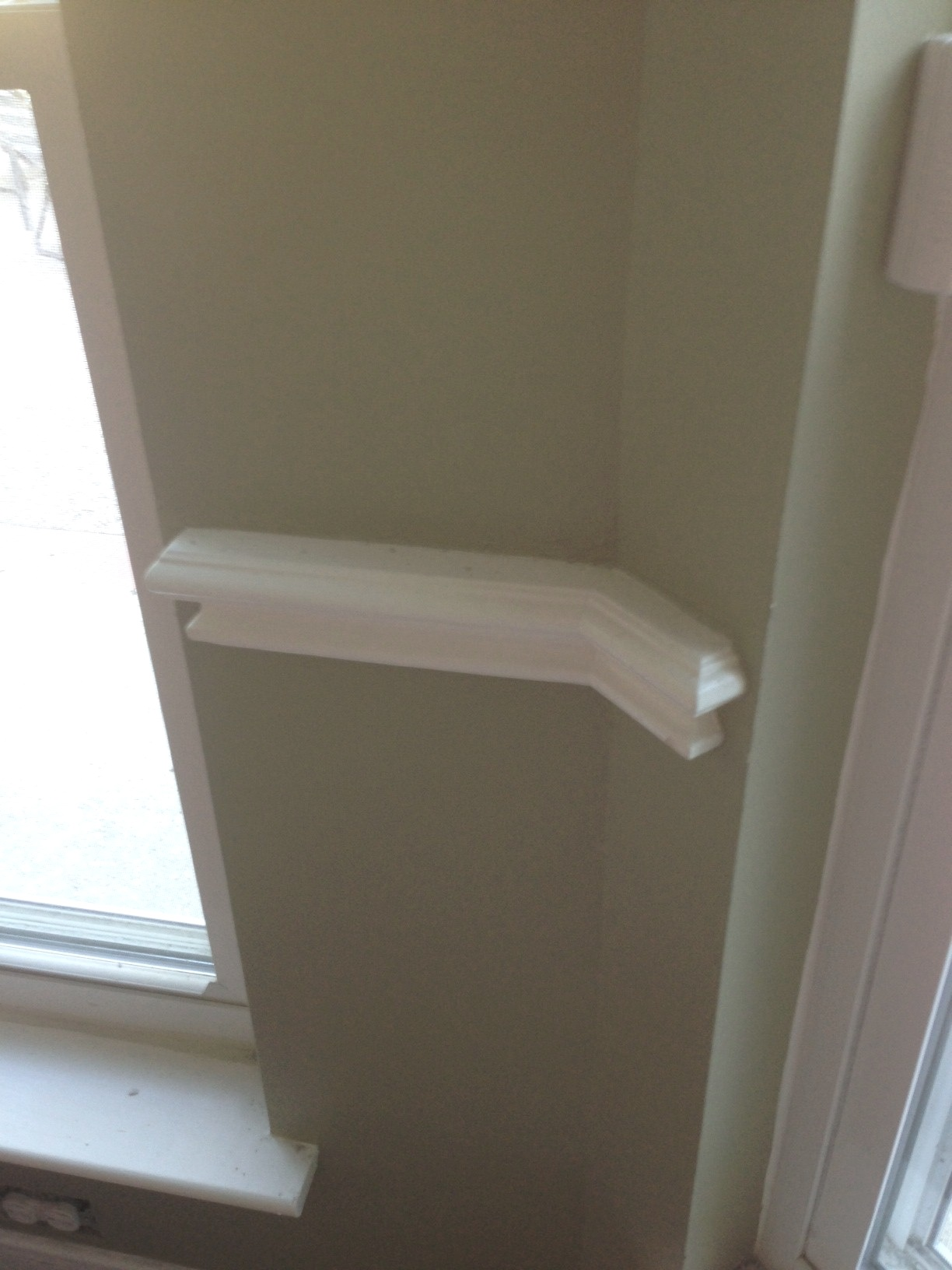Many times crown moulding or a chair rail will run around the room up until the point the wall stops, leaving no place to die the moulding into. If chair rail was to be used in this room, trimming out the windows would have been completed the look properly.