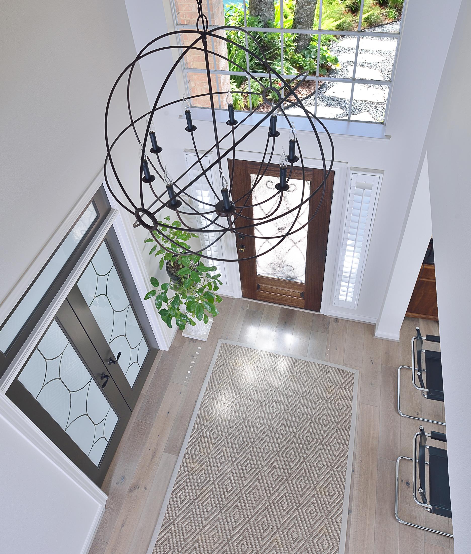 Entry hall foyer with seagrass, natural fiber rug | Carla Aston, Designer | Photographer: Miro Dvorscak #seagrassrug #entryhall #foyer #naturalfiberrug