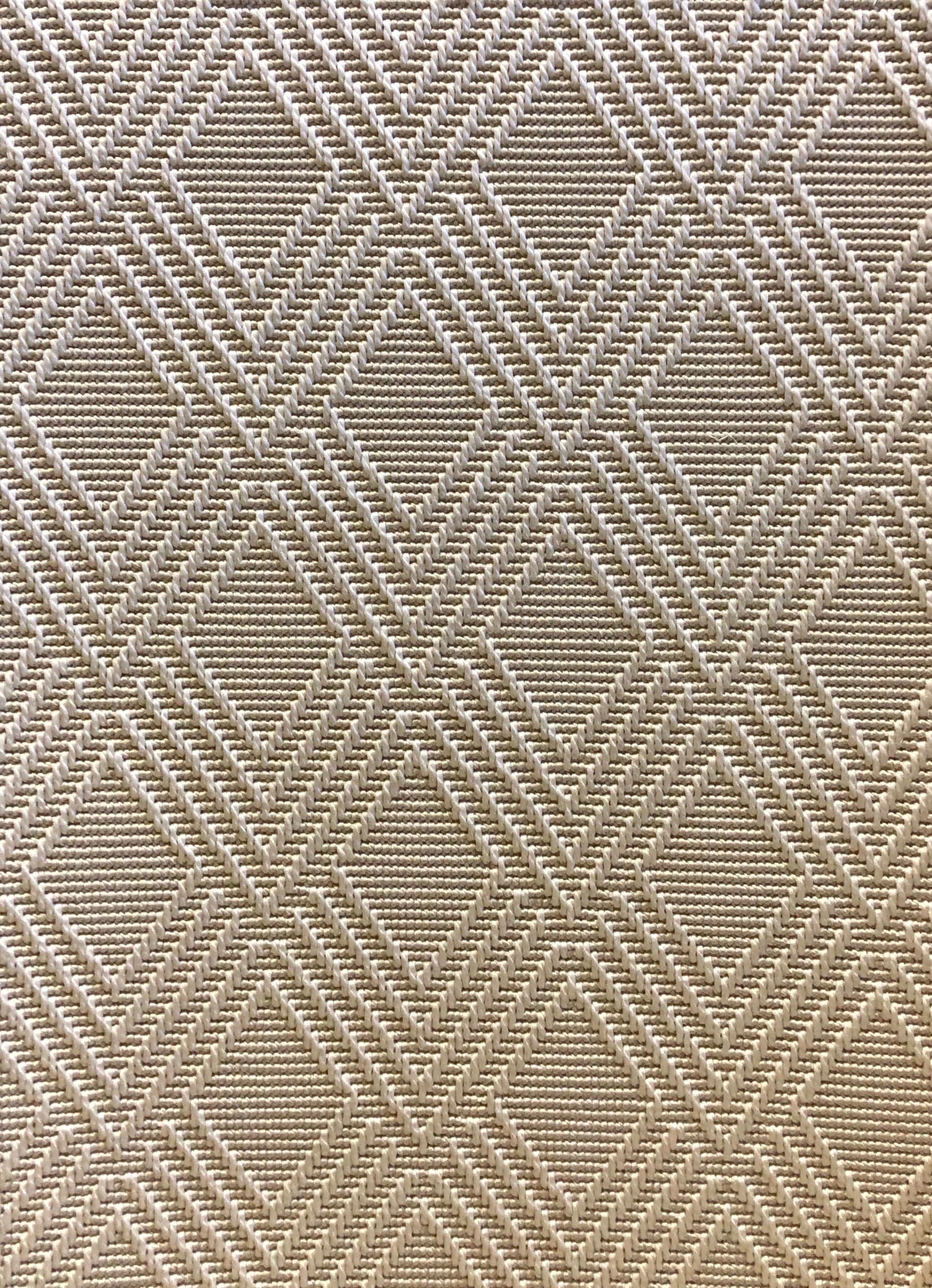 This carpet looks like a seagrass or sisal rug but is made of polypropylene and has none of the problems that some people have with natural fiber products.