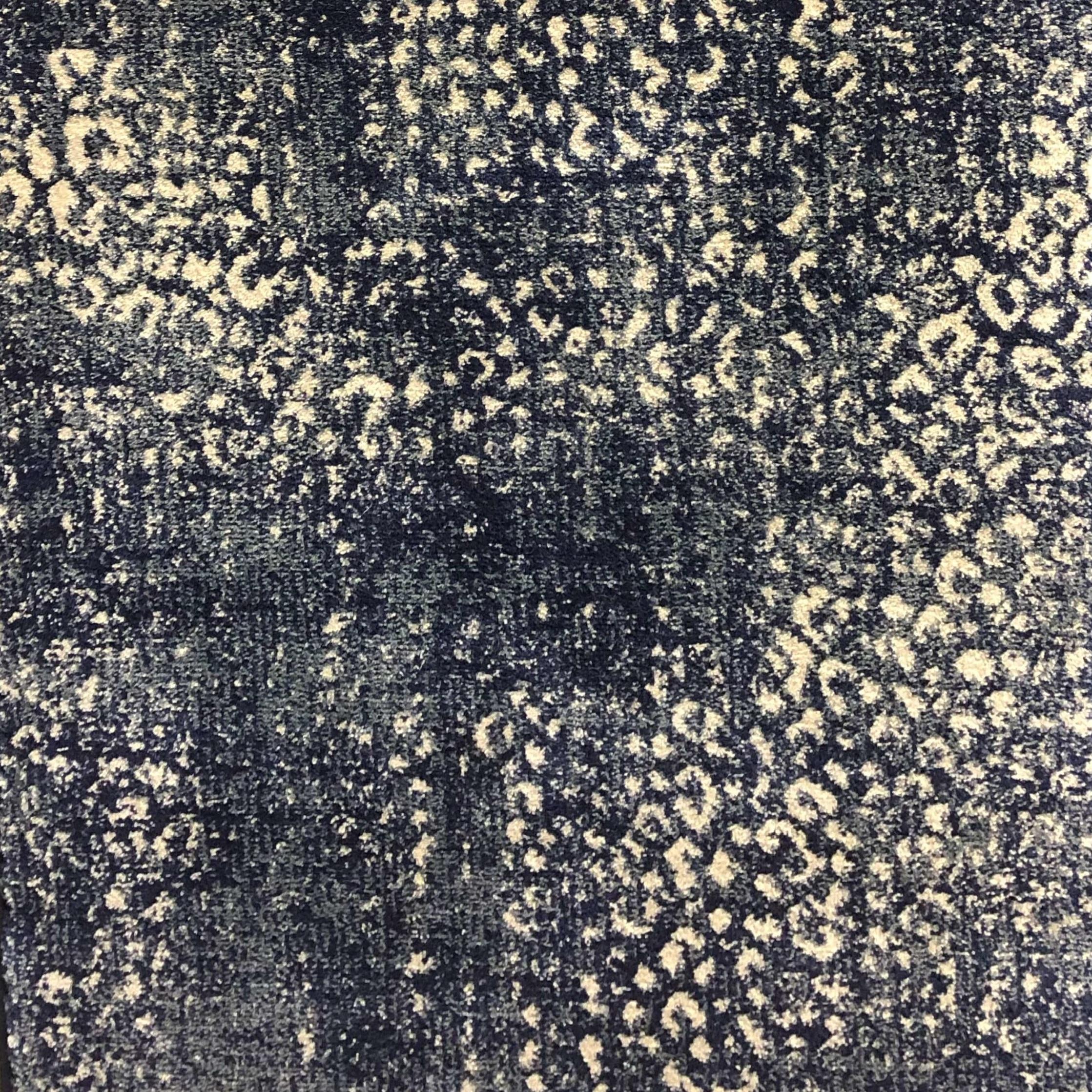 Love the navy blue version of this cheetah patterned carpet. Everyone loves an animal print! #rugideas #animalprintcarpet