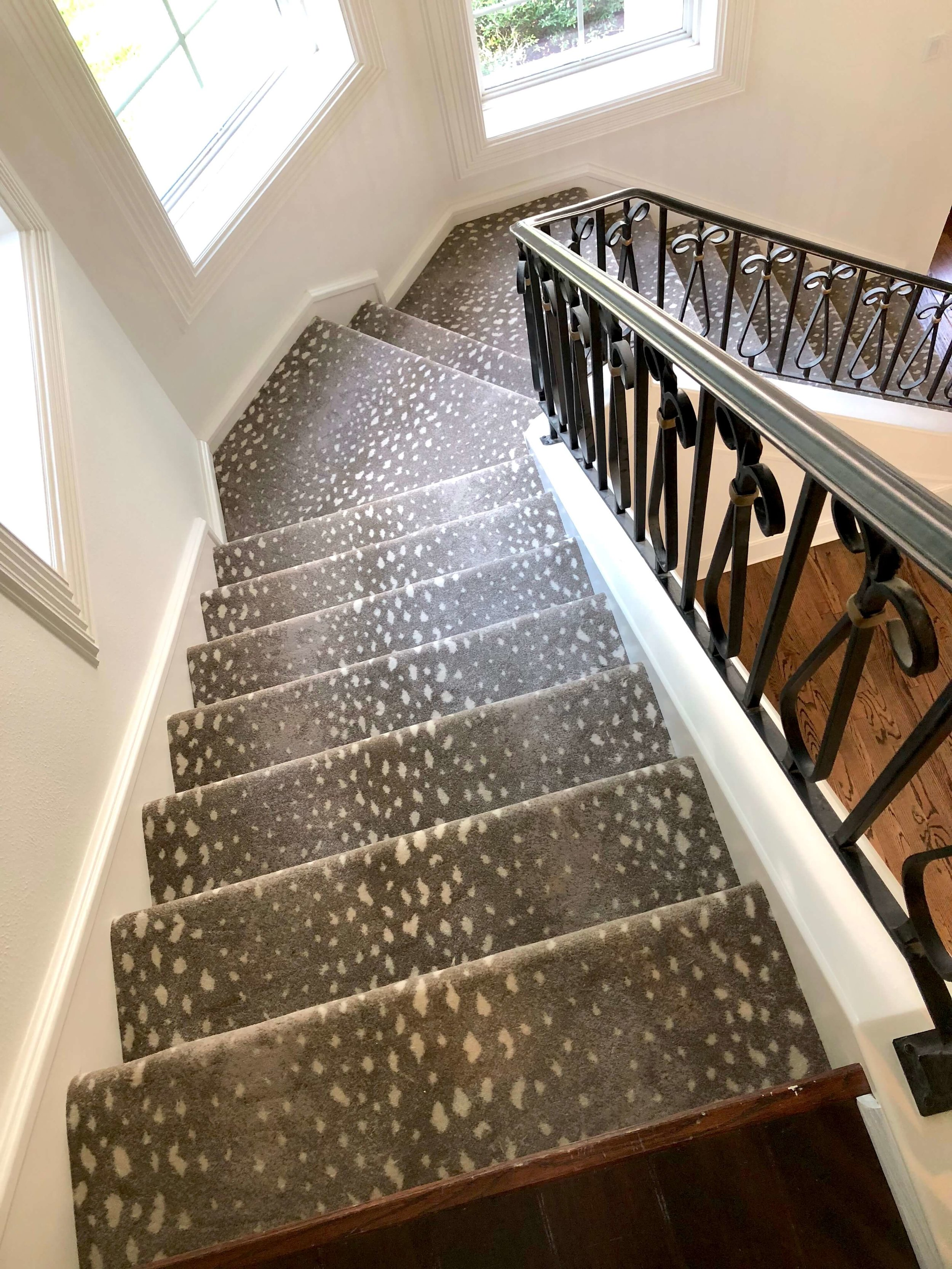 This antelope pattern carpet hides all kinds of soil and wears well on stairs. #animalprintcarpet #rugideas #rugs #stairrunner