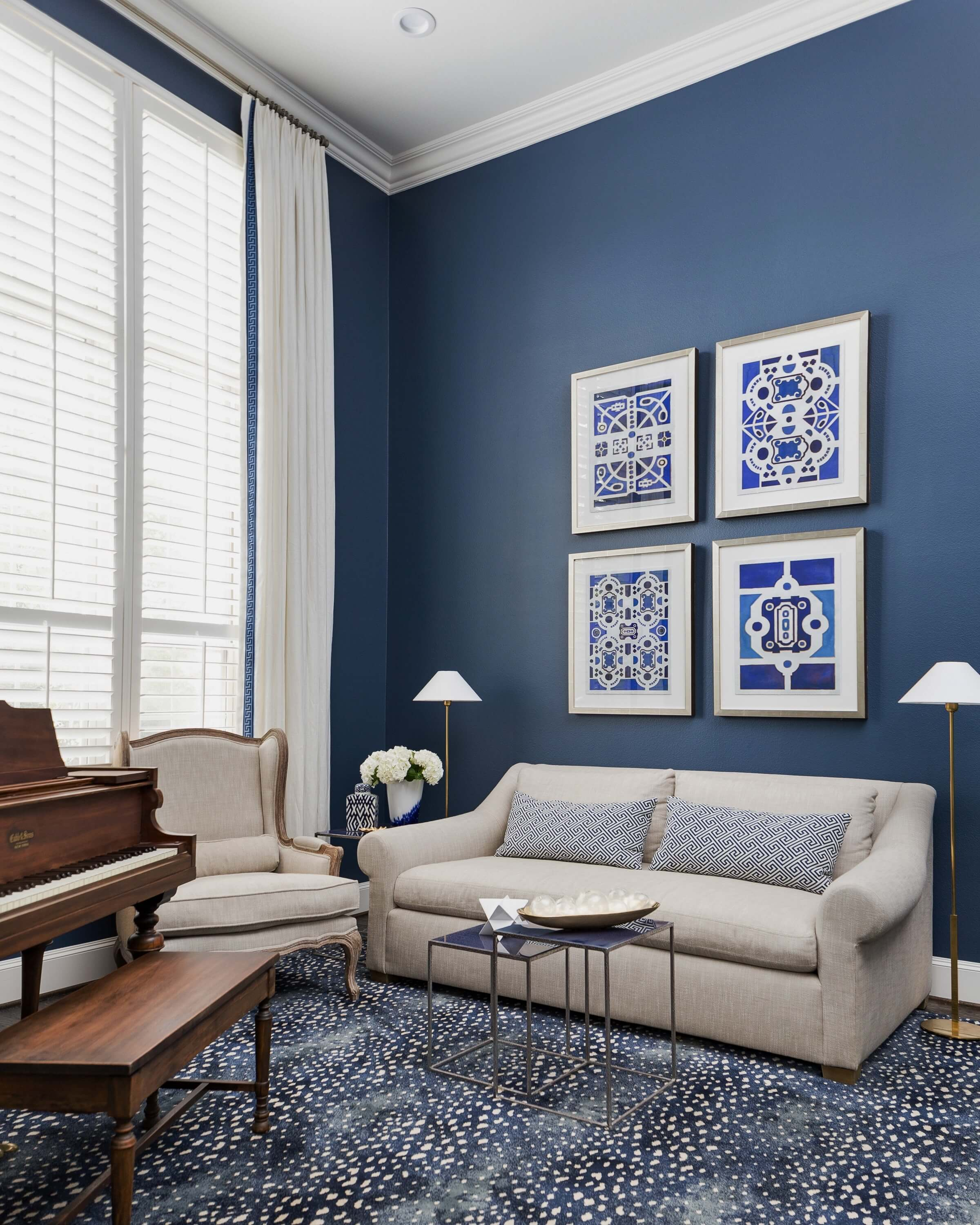 The antelope rug here makes a dynamic statement in this navy music room. #rugs #animalprintcarpet #rugideas #musicroom