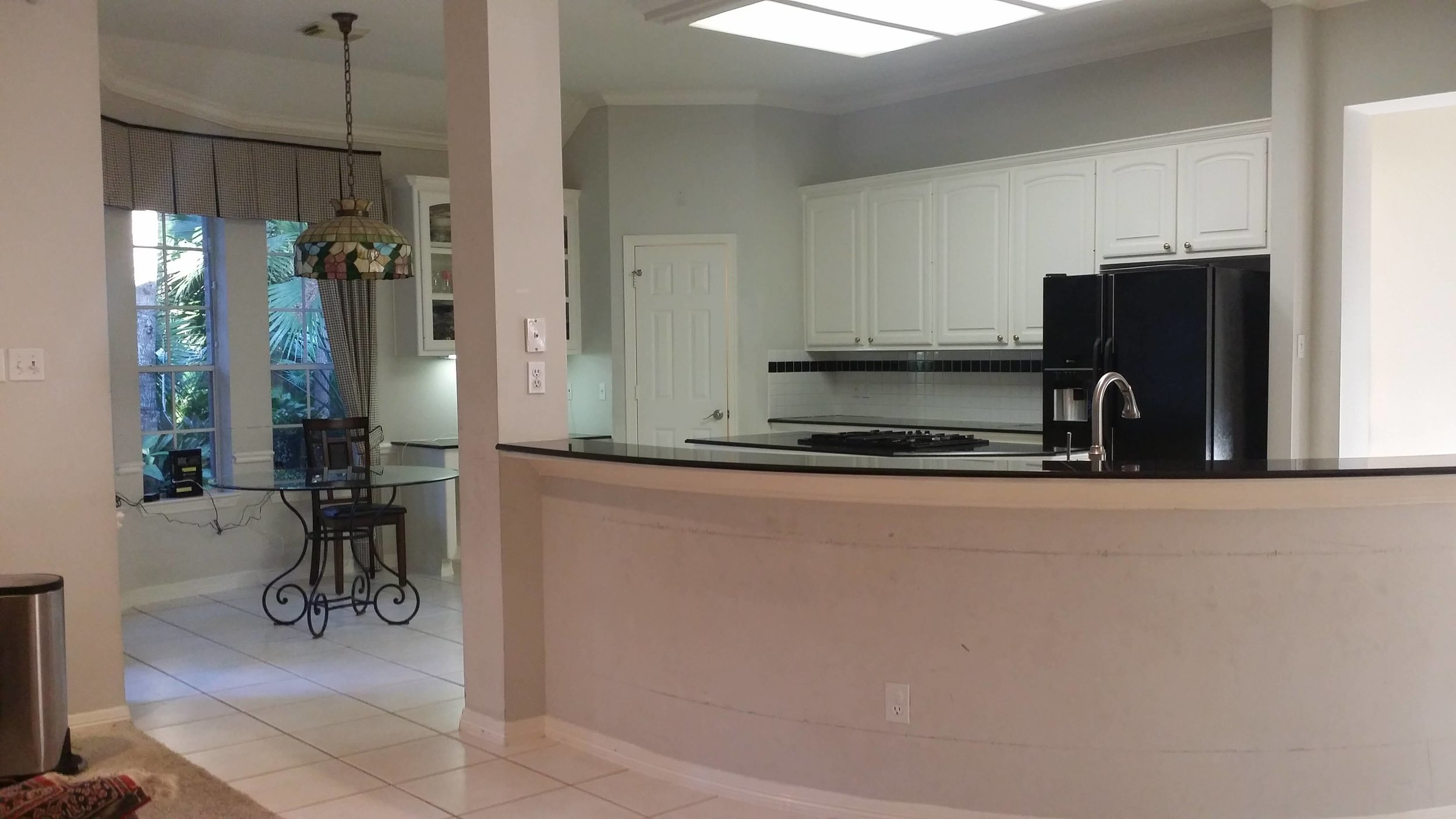 BEFORE - Sheetrock facing on bar and column that received high touch and traffic in this home. All were paneled in this remodel for a more cleanable surface and upgraded look. #kitchenbar #kitchendesign