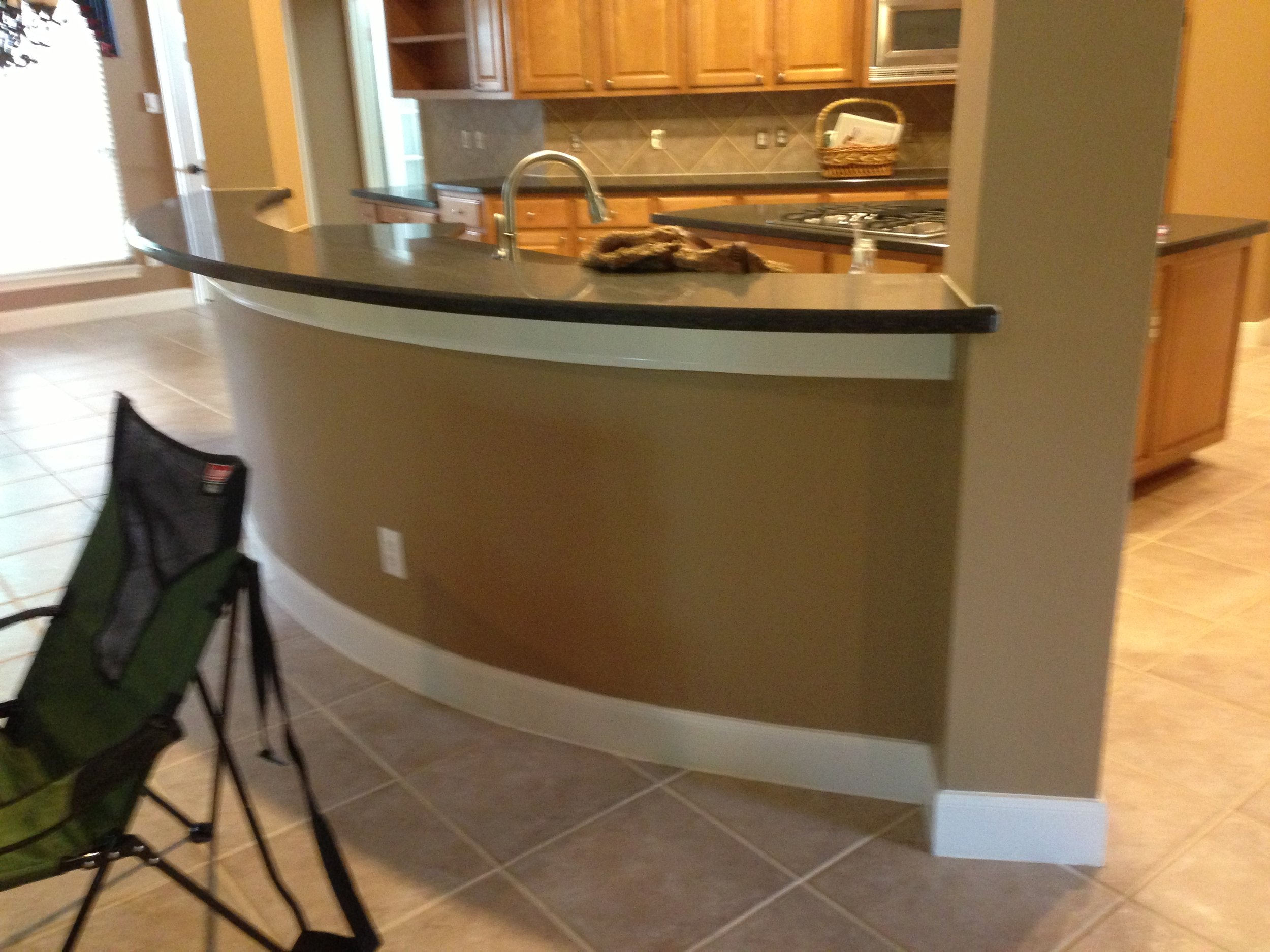 BEFORE - Bar face at kitchen with painted sheetrock finish