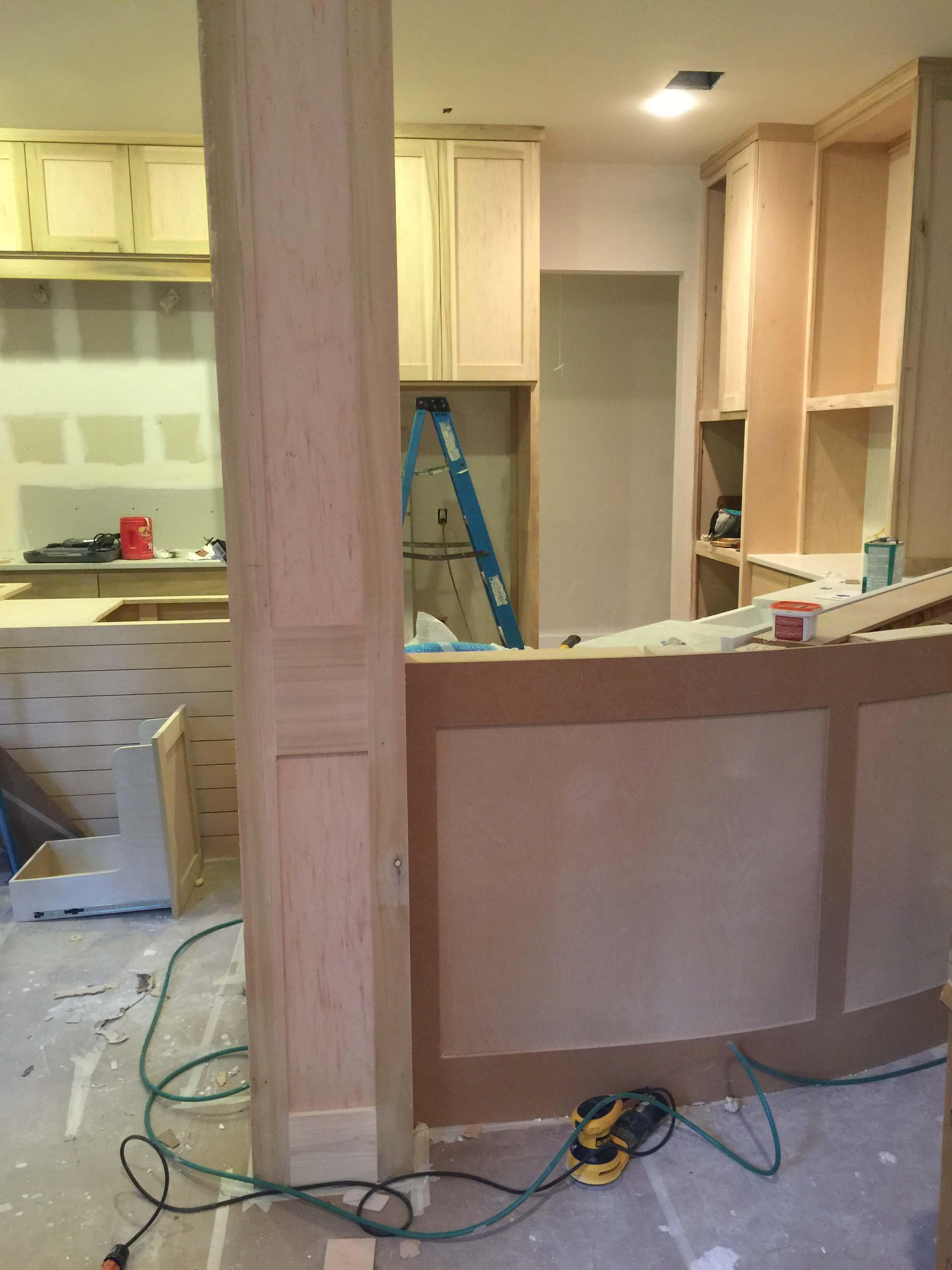 IN PROGRESS - Kitchen column and bar face getting paneled in kitchen remodel | Carla Aston, Designer