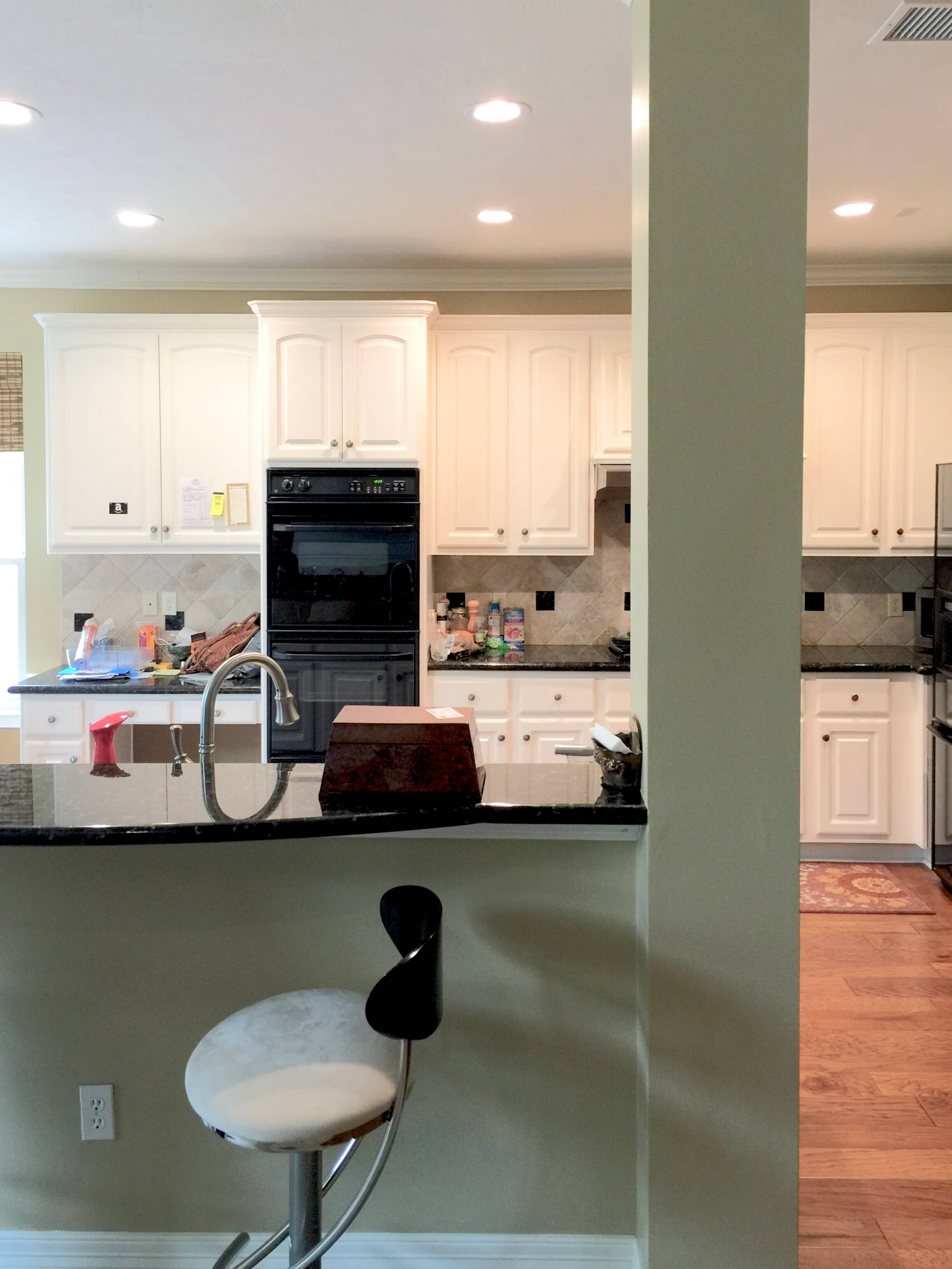 BEFORE - Bar front at kitchen with painted sheetrock face below the countertop.