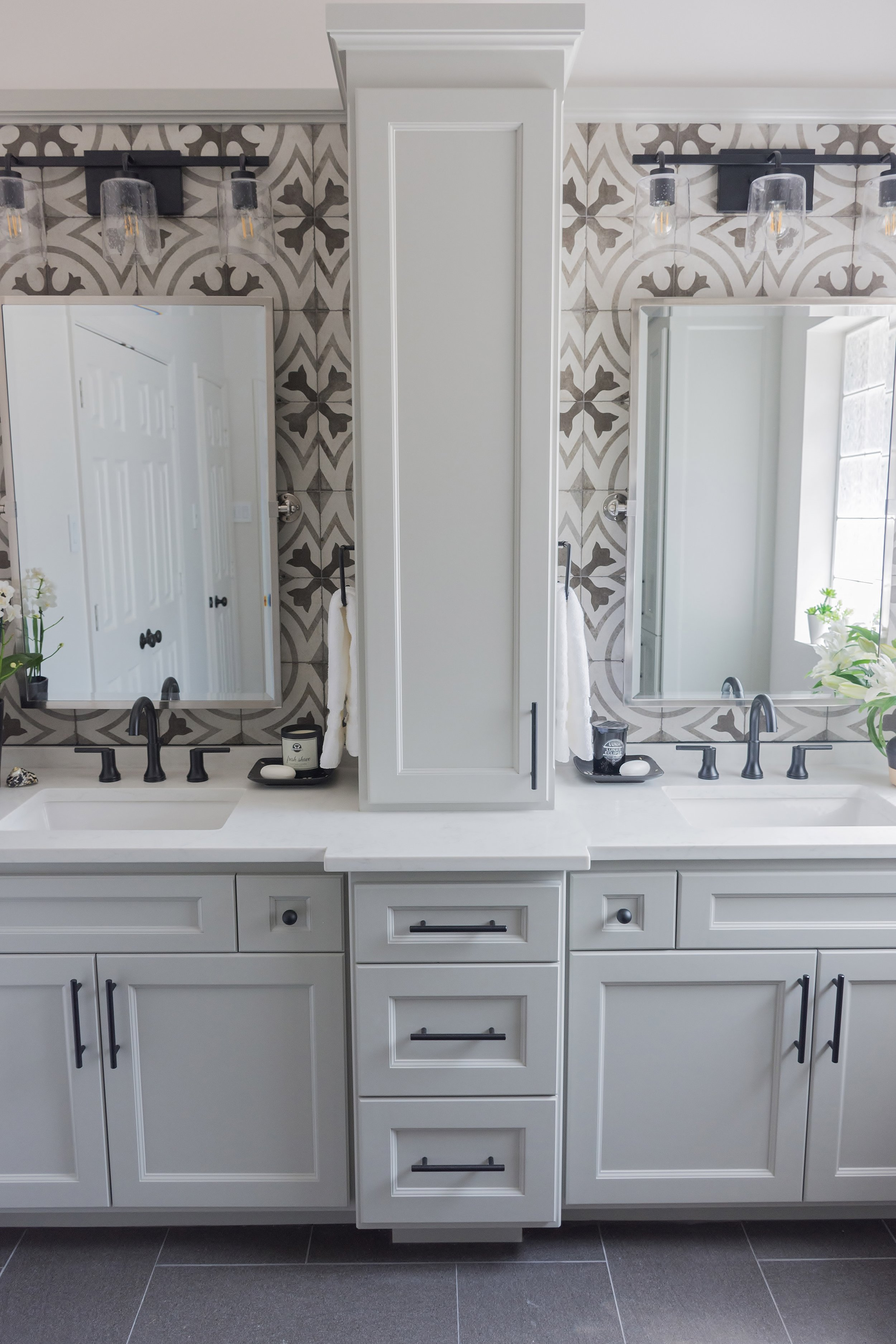 This single tall tower adds much needed storage and creates two more private vanity areas. Carla Aston, Designer | Charles Behrend, Photographer #bathroomvanity #bathroomcabinet #bathroomdesign
