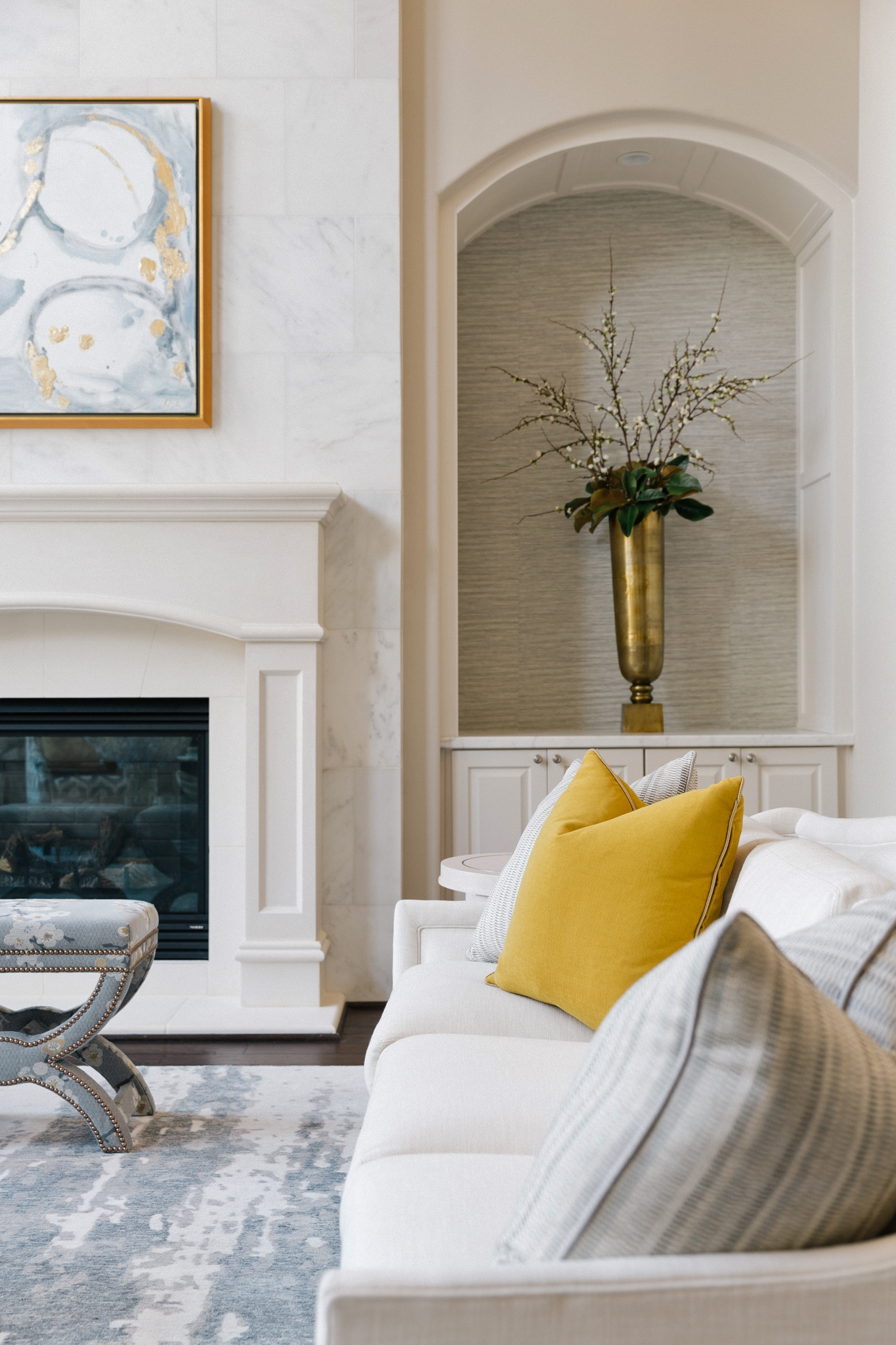 Living room with soft blue grays, creamy whites and bright yellow accented in custom pillows. | Interior Designer: Carla Aston #pillows #livingroomideas #homedecor