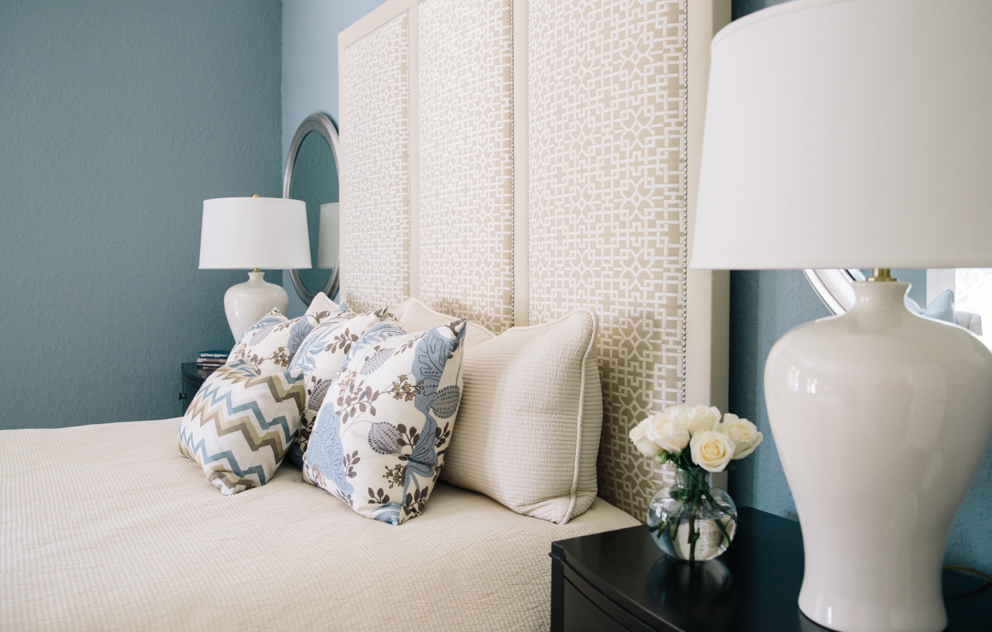 Master bedroom with custom pillows that add pattern and interest to this space. | Interior Designer: Carla Aston #pillows #patternedpillows #bluepillows #homedecor