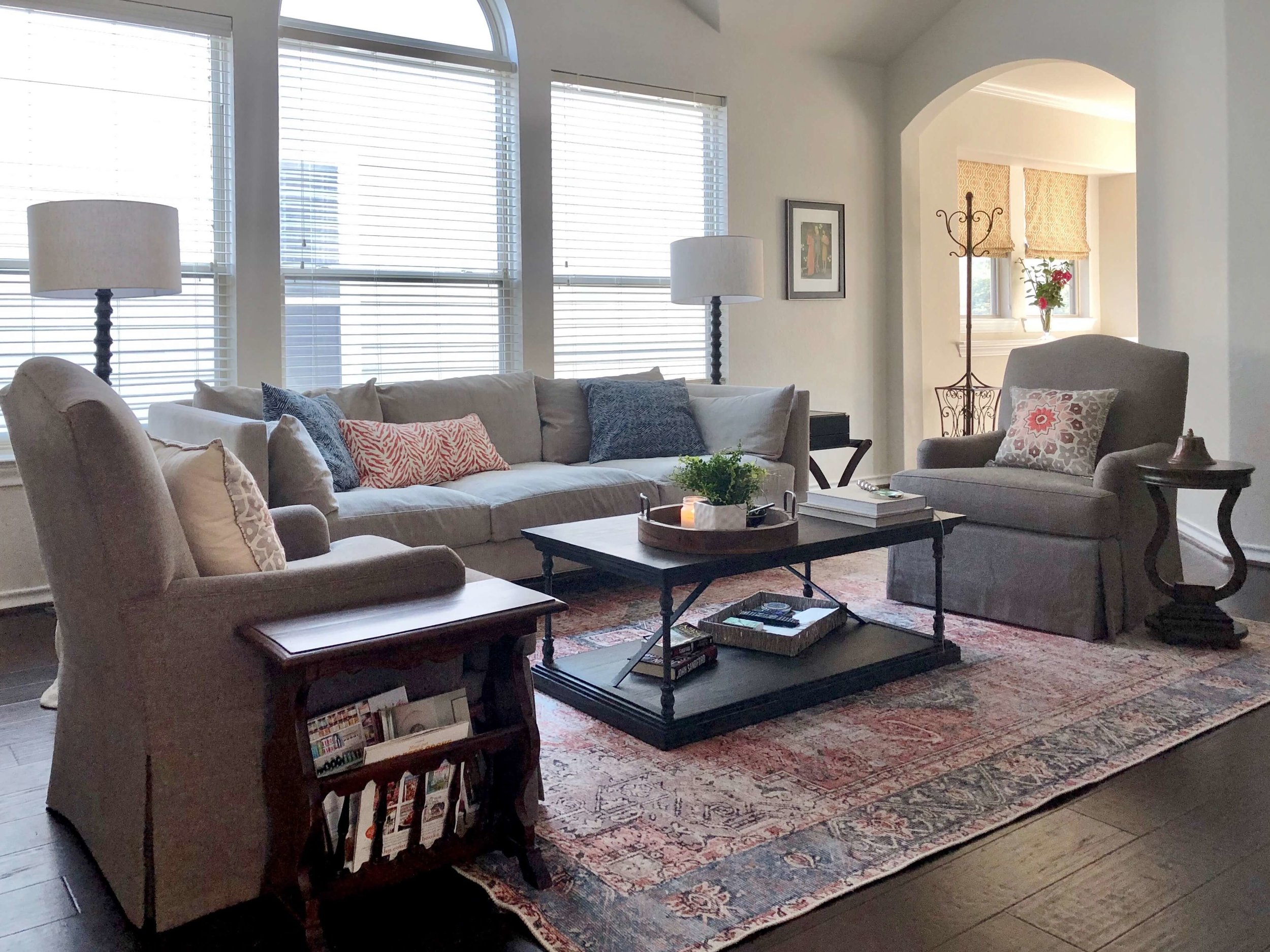 A simple, clean-lined sofa and these quality lounge chairs in gray fabrics provide a nice base for pillows and a rug in the homeowner's preferred palette.