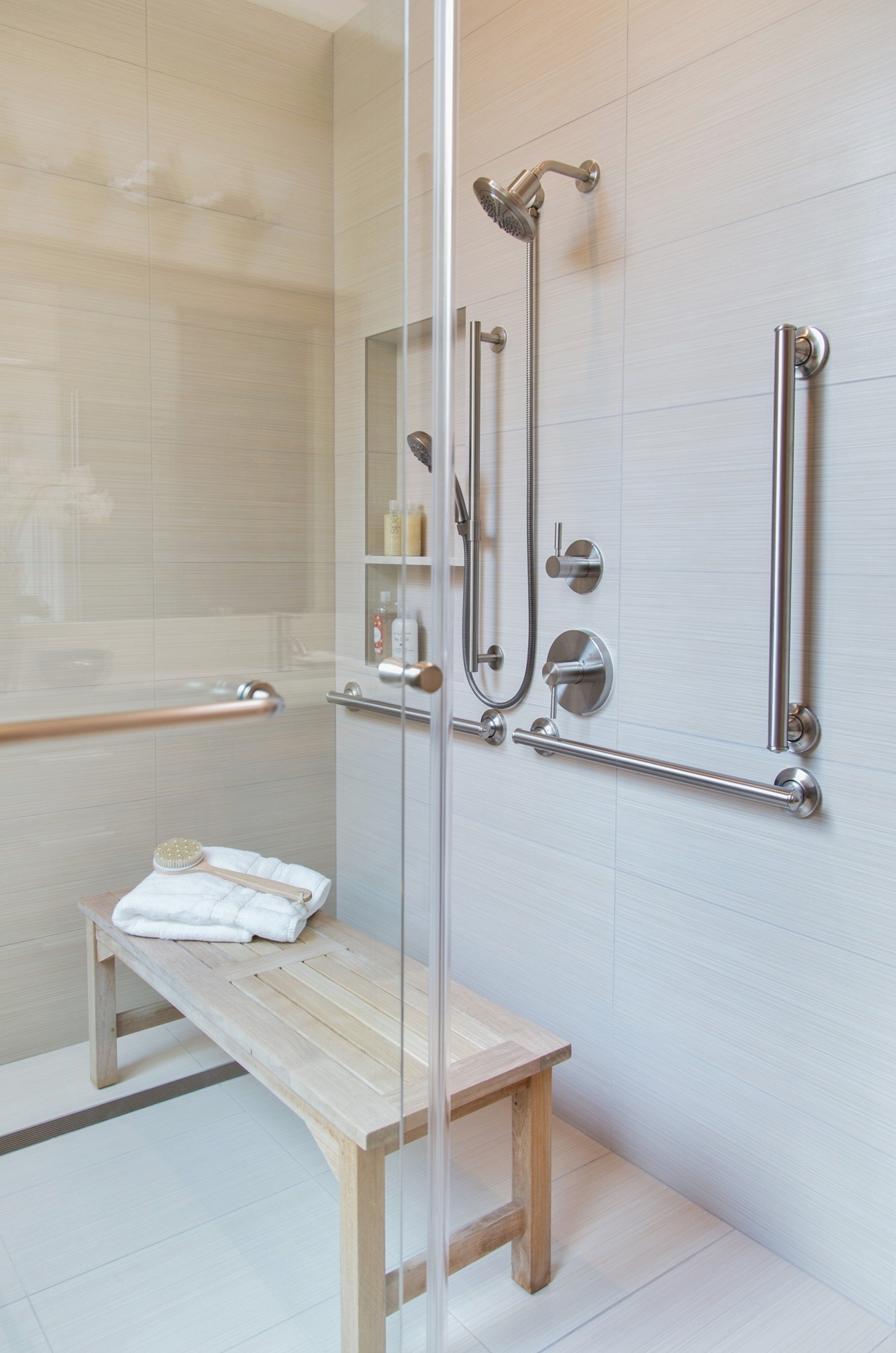 Bathroom designed for safety, ease of use while sitting, and beauty with curbless shower and grab bars. Carla Aston, Designer | Tori Aston, Photographer | #grabbars #bathroomdesign #aginginplace