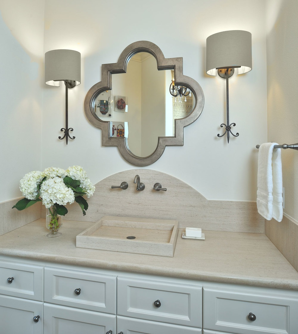 These sconces work well with the quatrefoil mirror in this powder bath. Carla Aston, Designer Sconces work well with the #bathlight #vanitylight #wallsconce