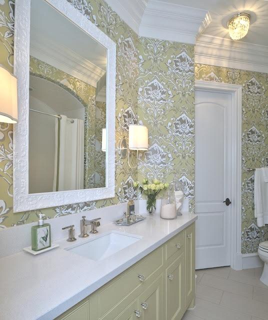 Sconces work well in this feminine bathroom. Carla Aston, Designer #bathlight #vanitylight #wallsconce