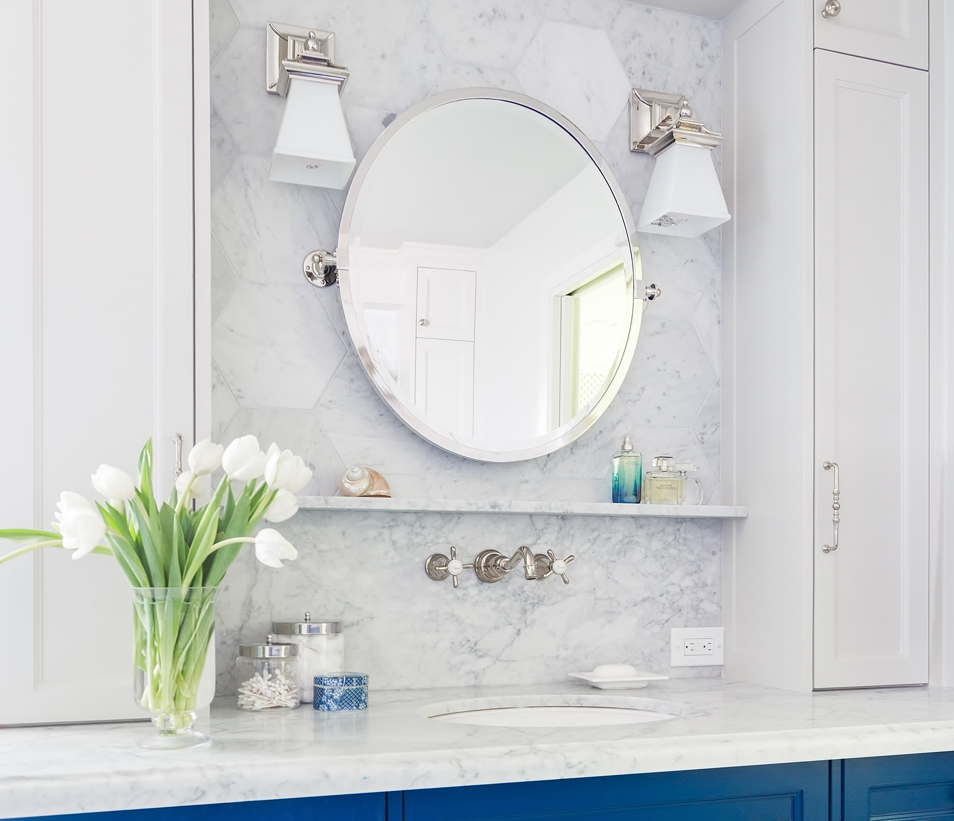 Two single sconces work better than a typical bath bar at the bathroom vanity. Carla Aston, Designer | Tori Aston, Photographer #vanitylight #bathroomdesign #bathroomsconces #bathlight