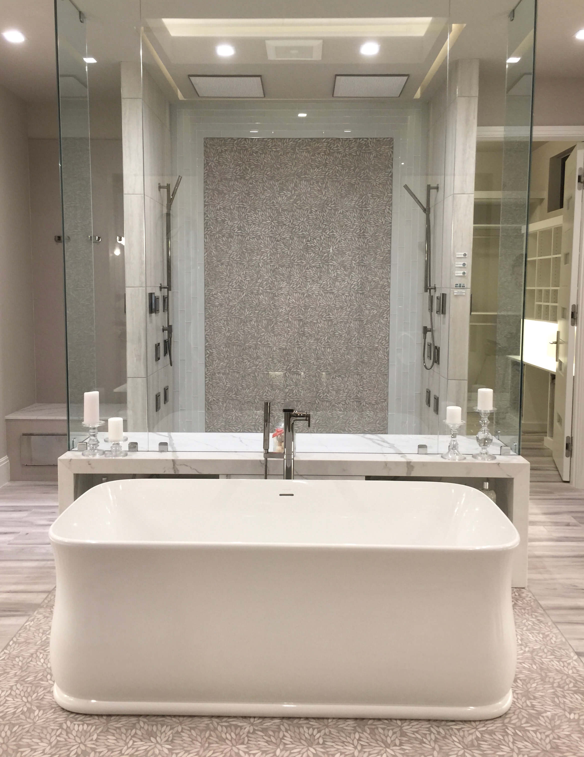 The lovely curves of this free standing tub balance the hard lines of the shower in this bathroom in The New American Home, seen at KBIS 2018. #tub #freestandingtub #bathroomdesign #bathroomideas