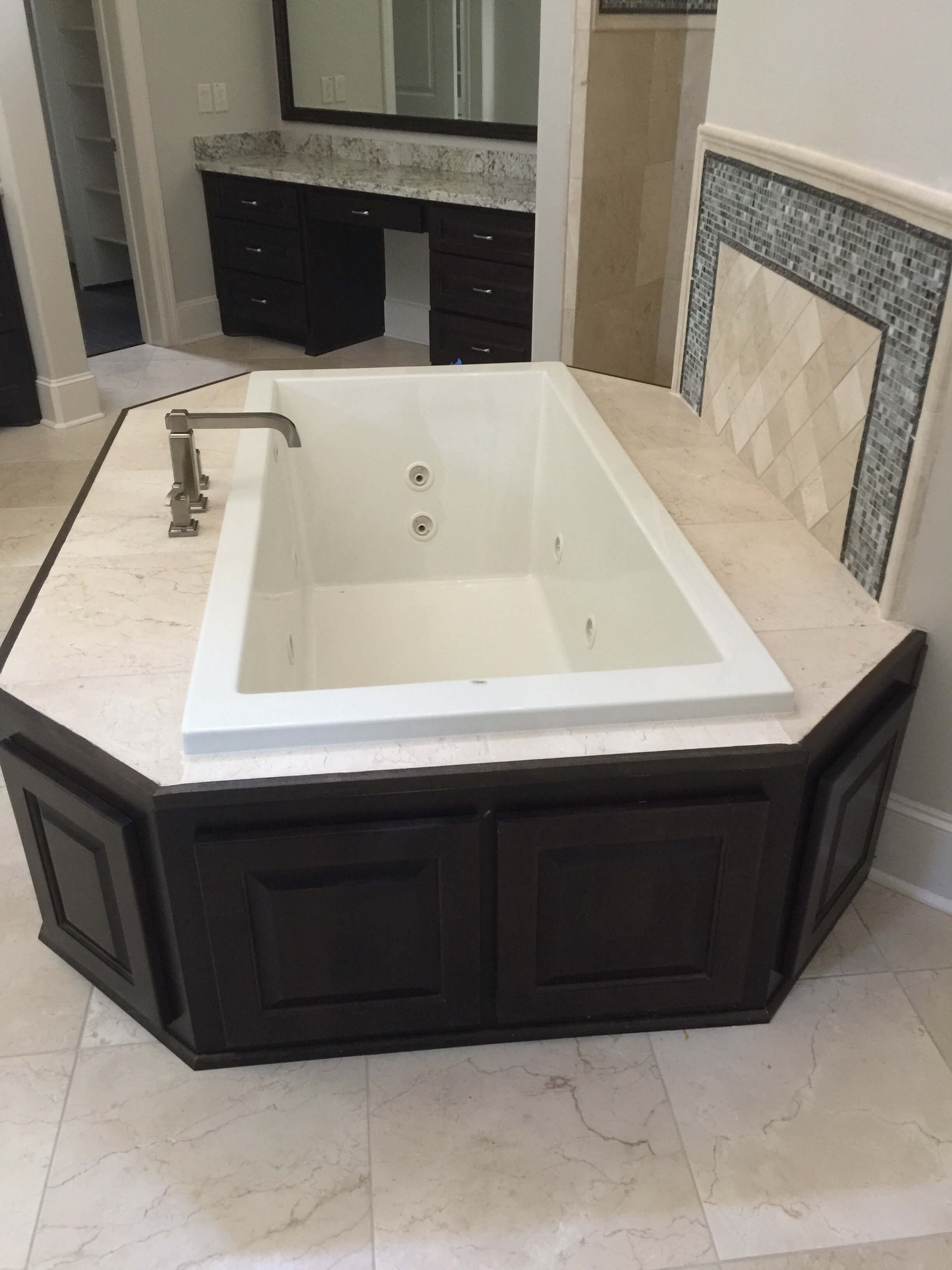 BEFORE  - The heavy surround of this deck mounted tub looked awkward floating out in the middle of this bathroom. #tub #bathroomdesign