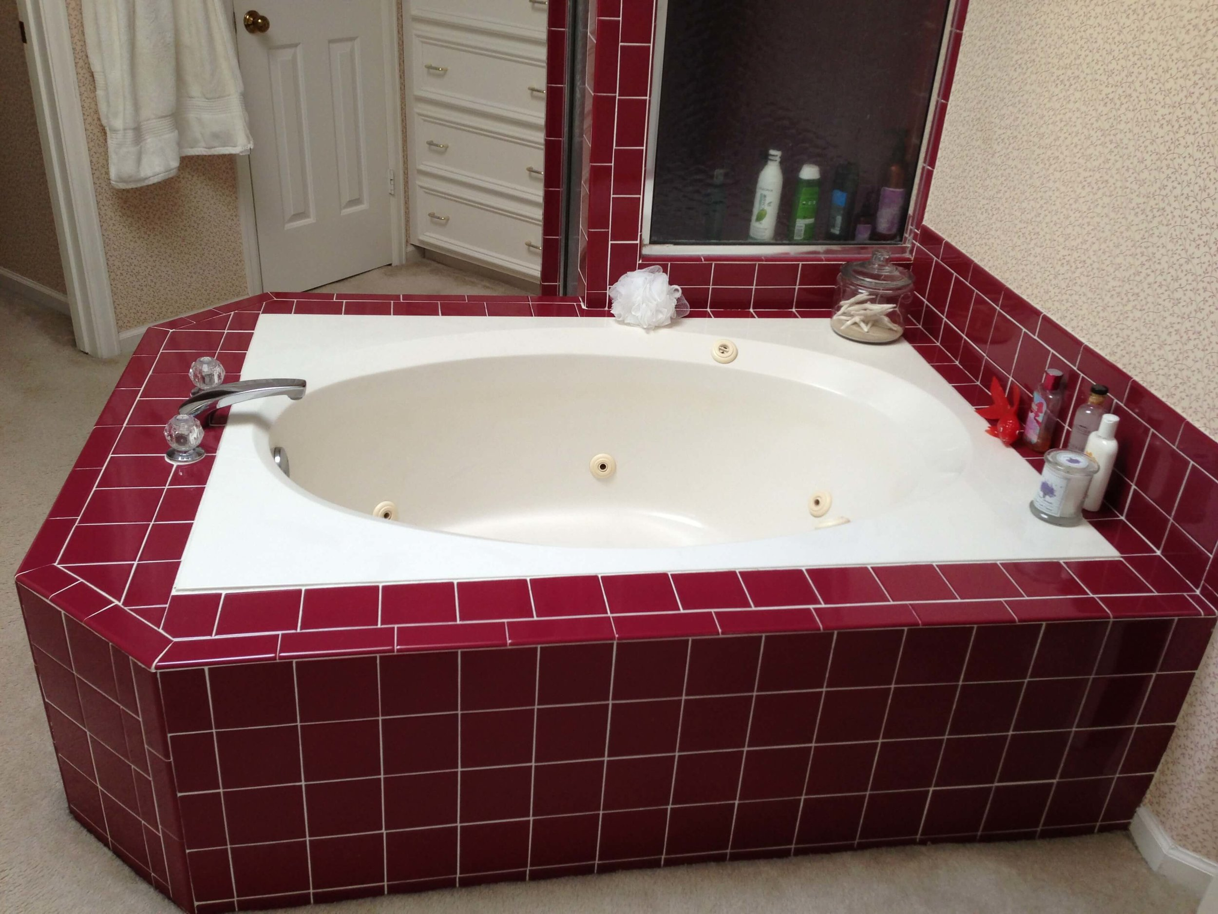 BEFORE  - This deck mounted tub projected out into the bath floor space and was a real eyesore in the room. #bathroomremodel #tub #bathroomdesign