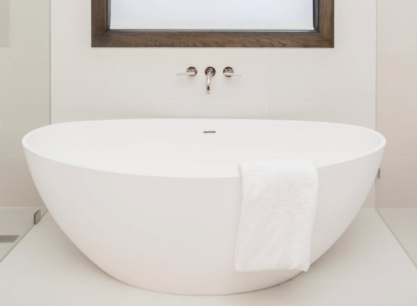 Free standing tub presents a sculptural shape in a contemporary form and feel lighter than a built-in tub with a surround. Carla Aston, Designer | Tori Aston, Photographer #freestandingtub #tub #bathroomdesign