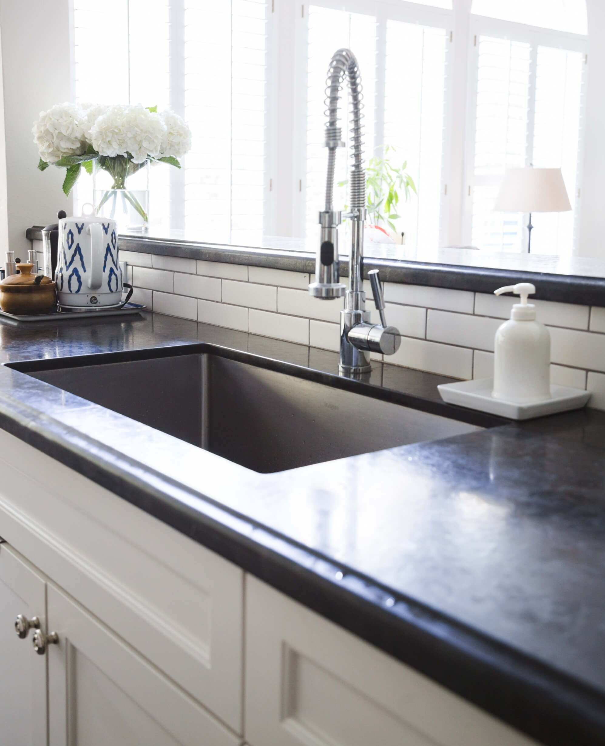 """My kitchen remodel with the 42"""" high raised bar at the kitchen sink. It hides the dishes in the sink, nicely. :-) Carla Aston, Designer 