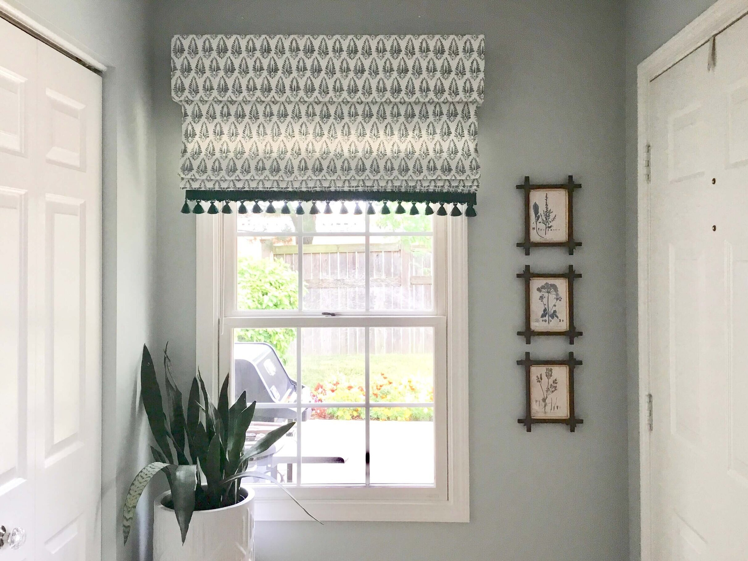 New window shade with trim at entry hall. #romanshade #windowtreatment #windowshade