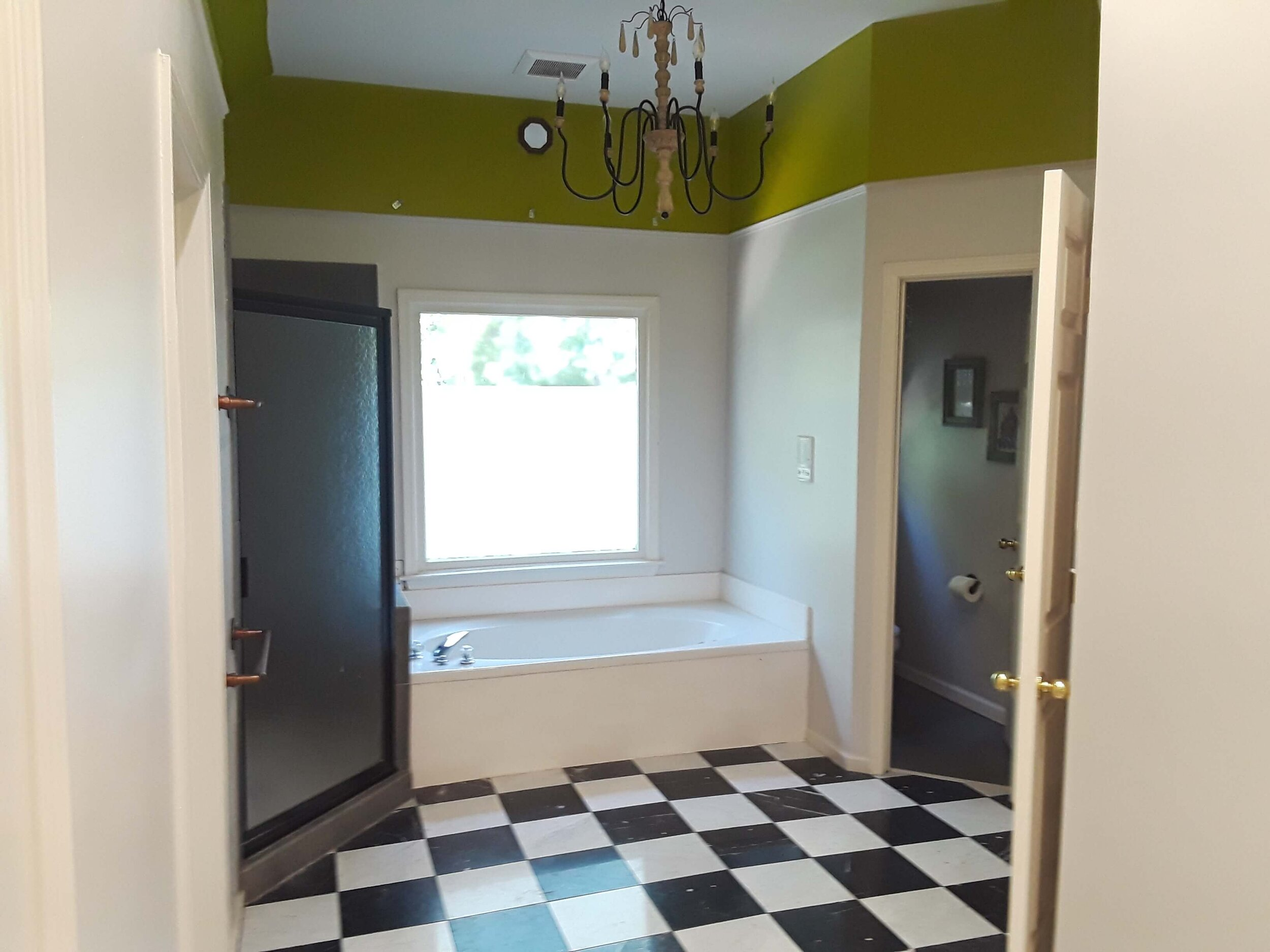 BEFORE REMODEL - This bathroom was going to be remodeled with a new tile floor, clear glass shower enclosure and different tile around the tub. What would work best here? #designconsultation #bathroomdesign #bathroomtile