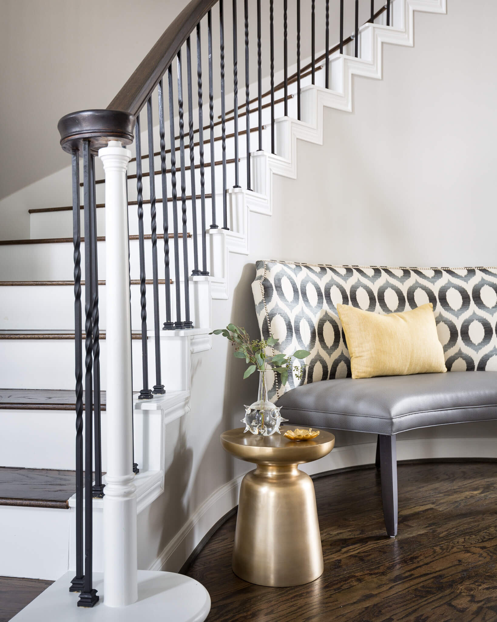 Brass side table in front entry hall of remodel project. | Carla Aston, Designer | Colleen Scott, Photographer | #brasshomedecor #brasstable #foyer #stair #curvedstair