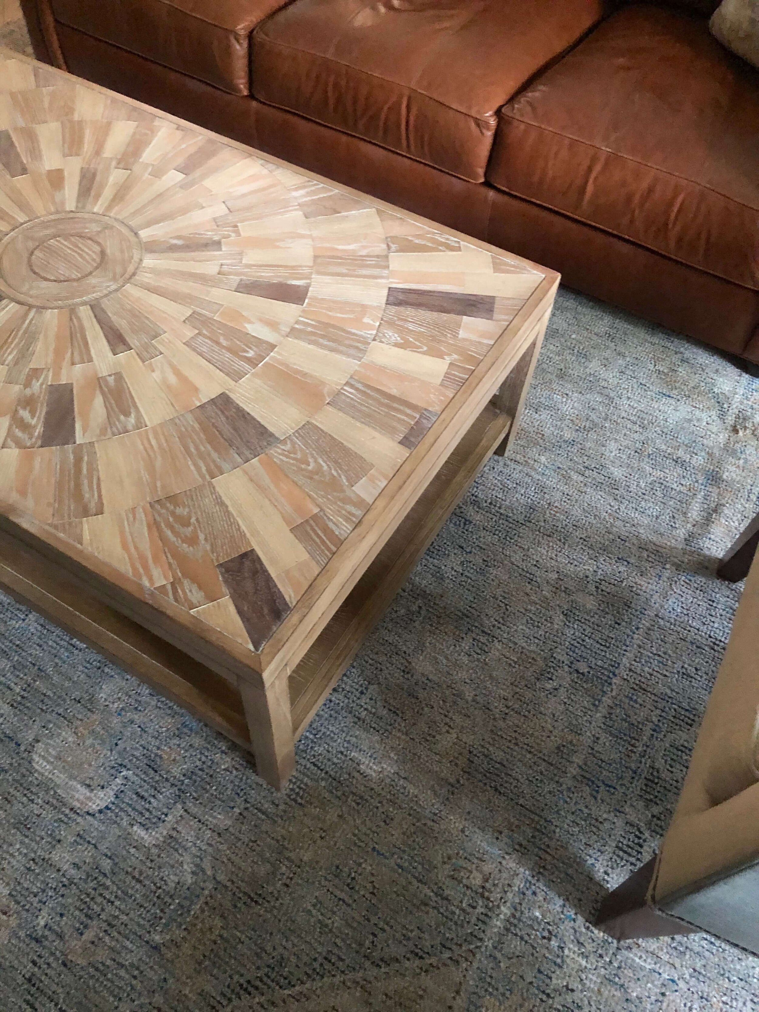 I really love this inlaid wood coffee table with the caramel leather sofa and subtly patterned blue green rug. This will be great when all finished up!
