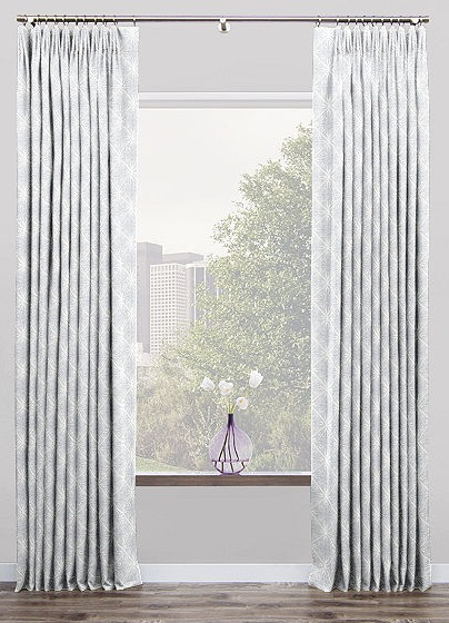 Tailored pleat drapery panels in subtle diamond gray and white pattern for window treatment in living room | Living Room Design Consultation #windowtreatment #draperies #livingroomideas