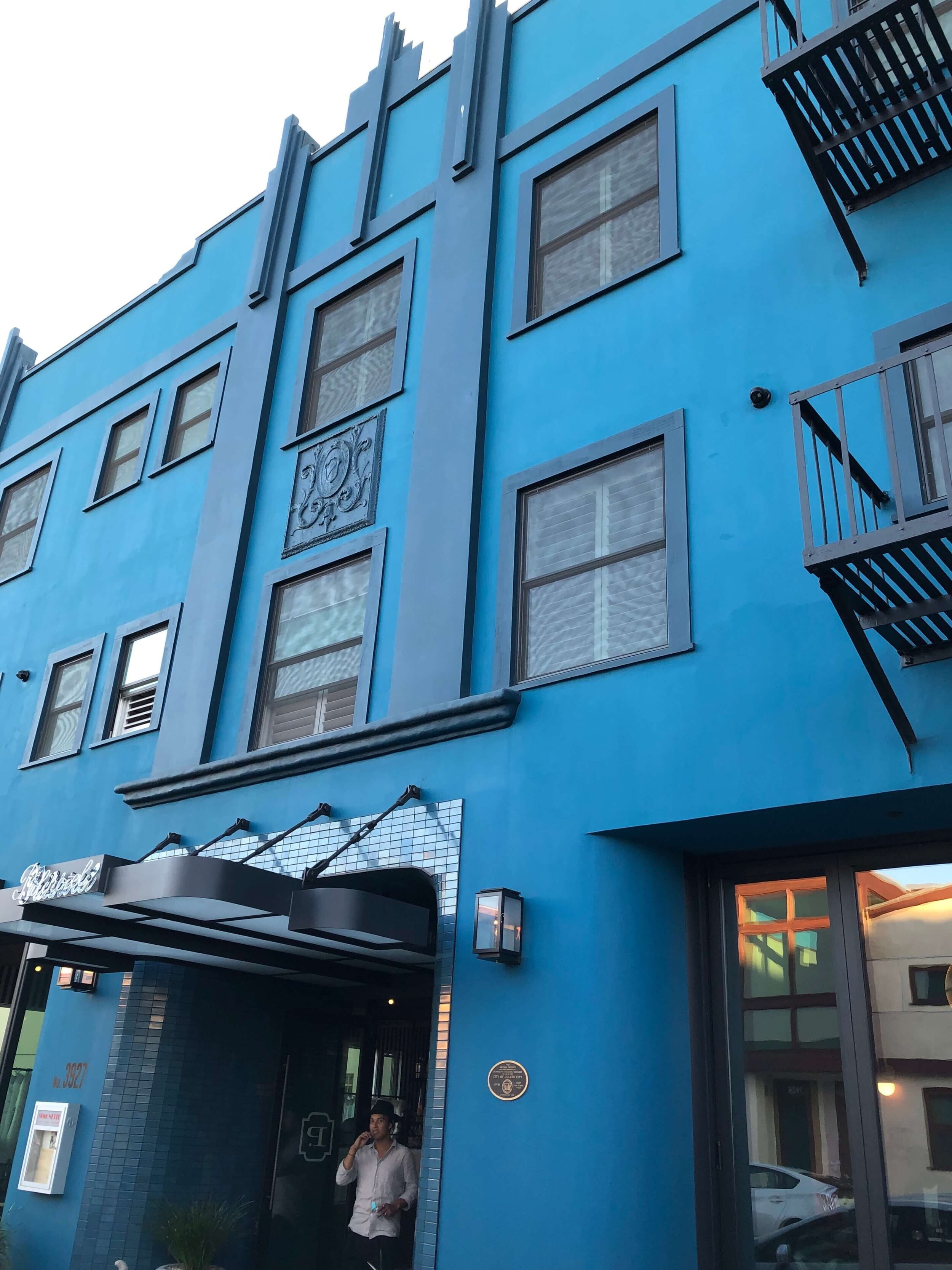 Vivid turquoise color on the exterior of the Palihotel, Culver City, a restored Art Deco building with a bohemian modern vibe. #artdeco #hotel #modernboho