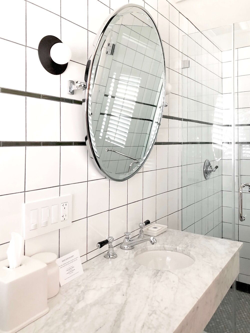Small Bathroom Design Tips - Hotel bathroom with Carrara marble countertop and small round sink.
