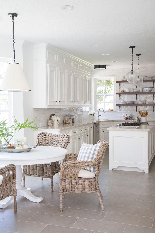Wood open shelves add interest in this white kitchen. | Designer, Carla Aston | Photographer, Tori Aston #whitekitchen