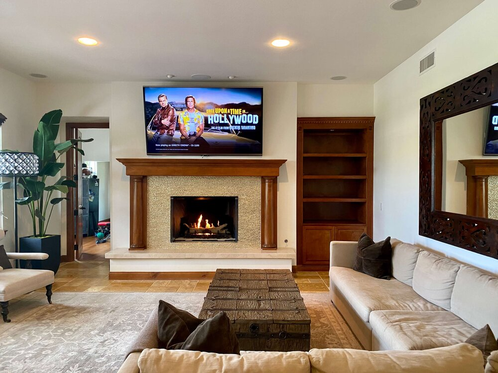 Fireplace wall to be redesigned - The traditional, Tuscan look was no longer appealing to this homeowner.