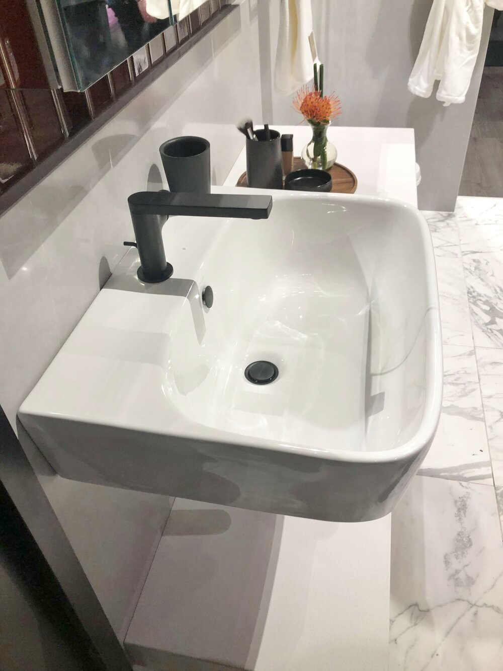Nice to have some space to set items on the decked area of this wall mount sink.