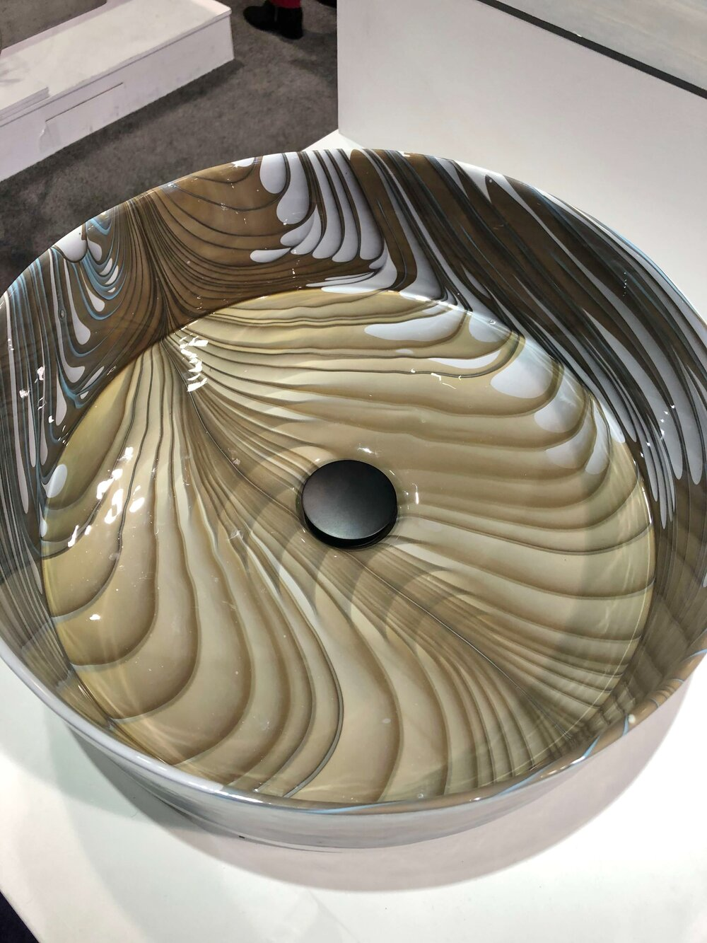 Murano glass vessel sink with a wavy beige pattern by Native Trails