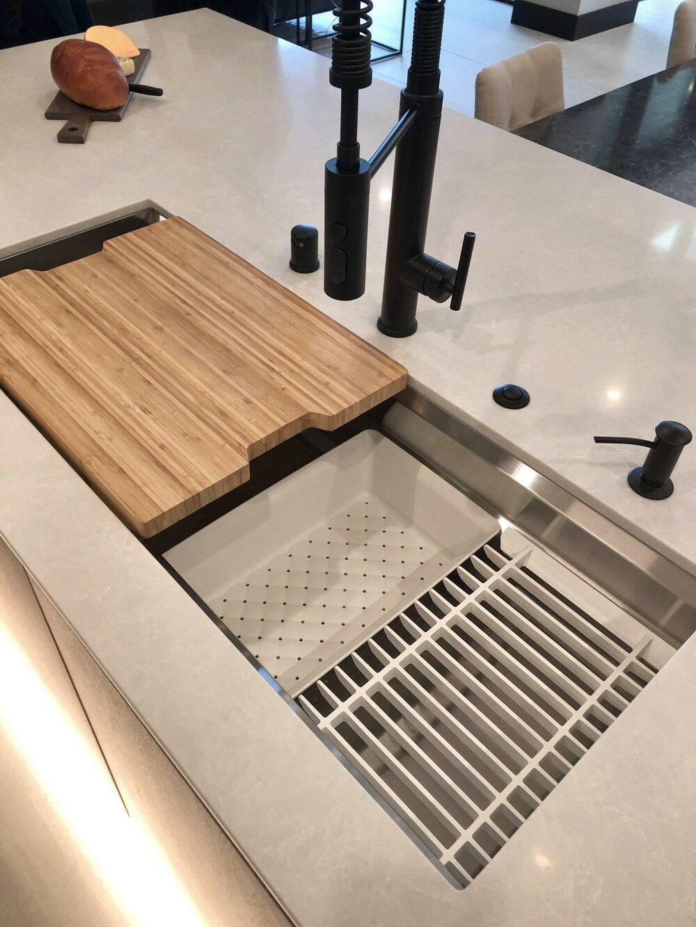 This fab layered sink from Kohler helps get so much more function in the sink. The New American Remodel TNAR | #remodeling #remodel #kitchenideas #kitchendesign
