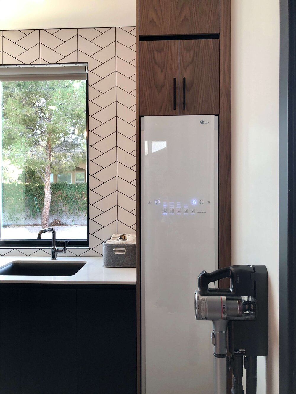 The LG Styler built in the laundry room of The New American Remodel. TNAR | #remodeling #remodel #laundryroom